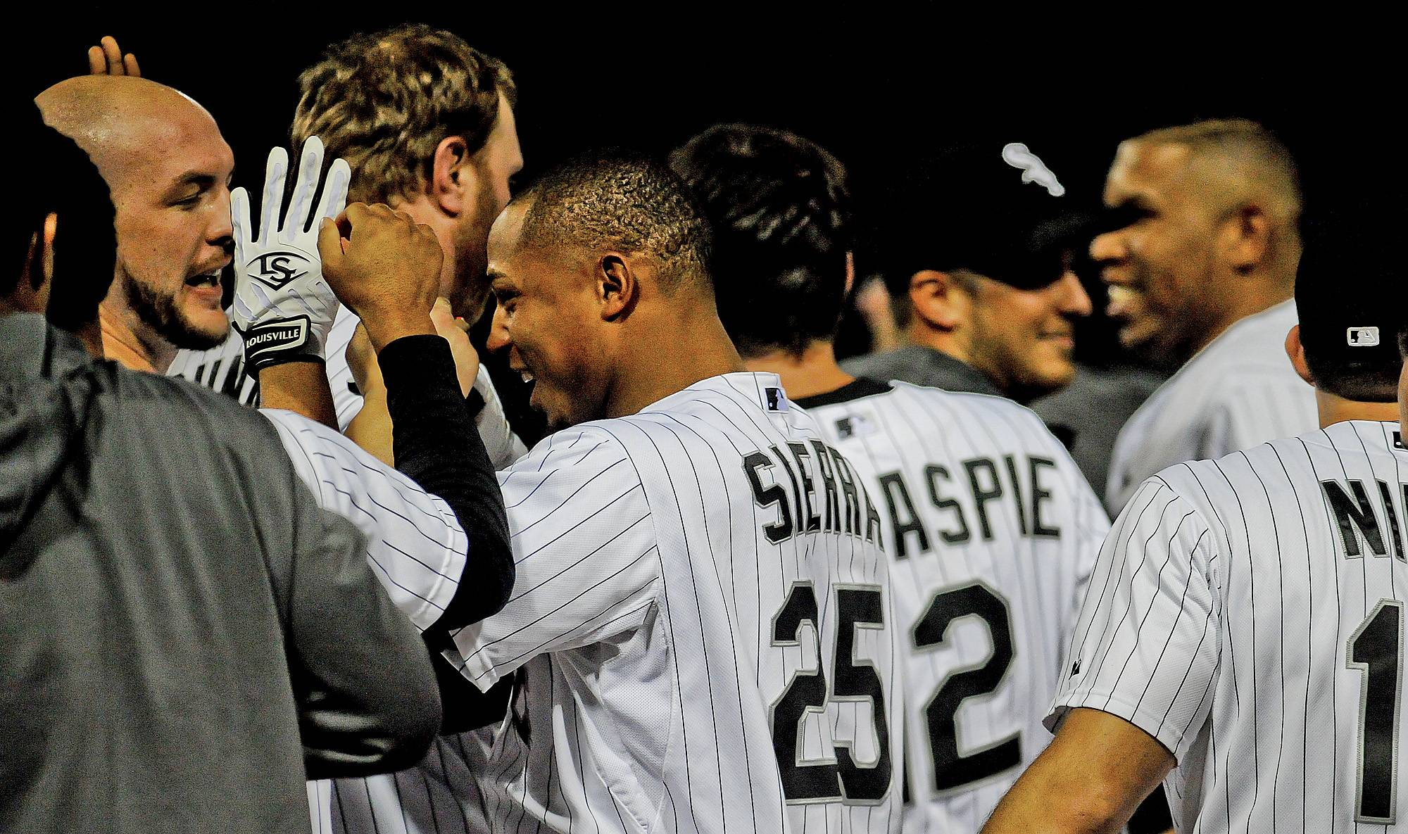 Chicago White Sox's Moises Sierra (25) is congratulated by teammates after hitting the game-winning single in the ninth inning of a baseball game against the Cleveland Indians in Chicago on Wednesday, May 28, 2014. (AP Photo/Matt Marton)