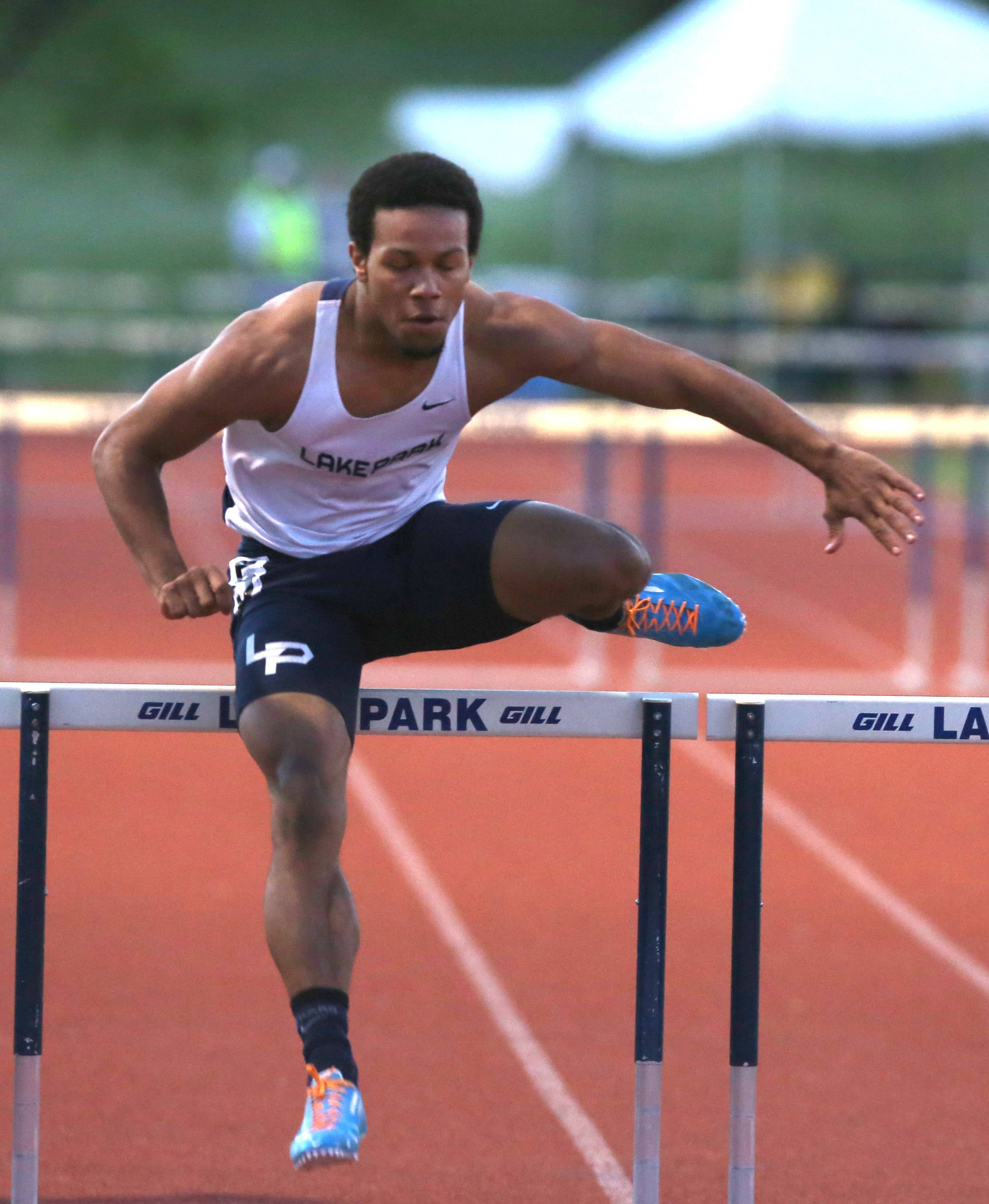 Lake Park's Antonio Shenault runs the 300 Meter Hurdles during the Lake Park Boys Track & Feld Sectional Championships.