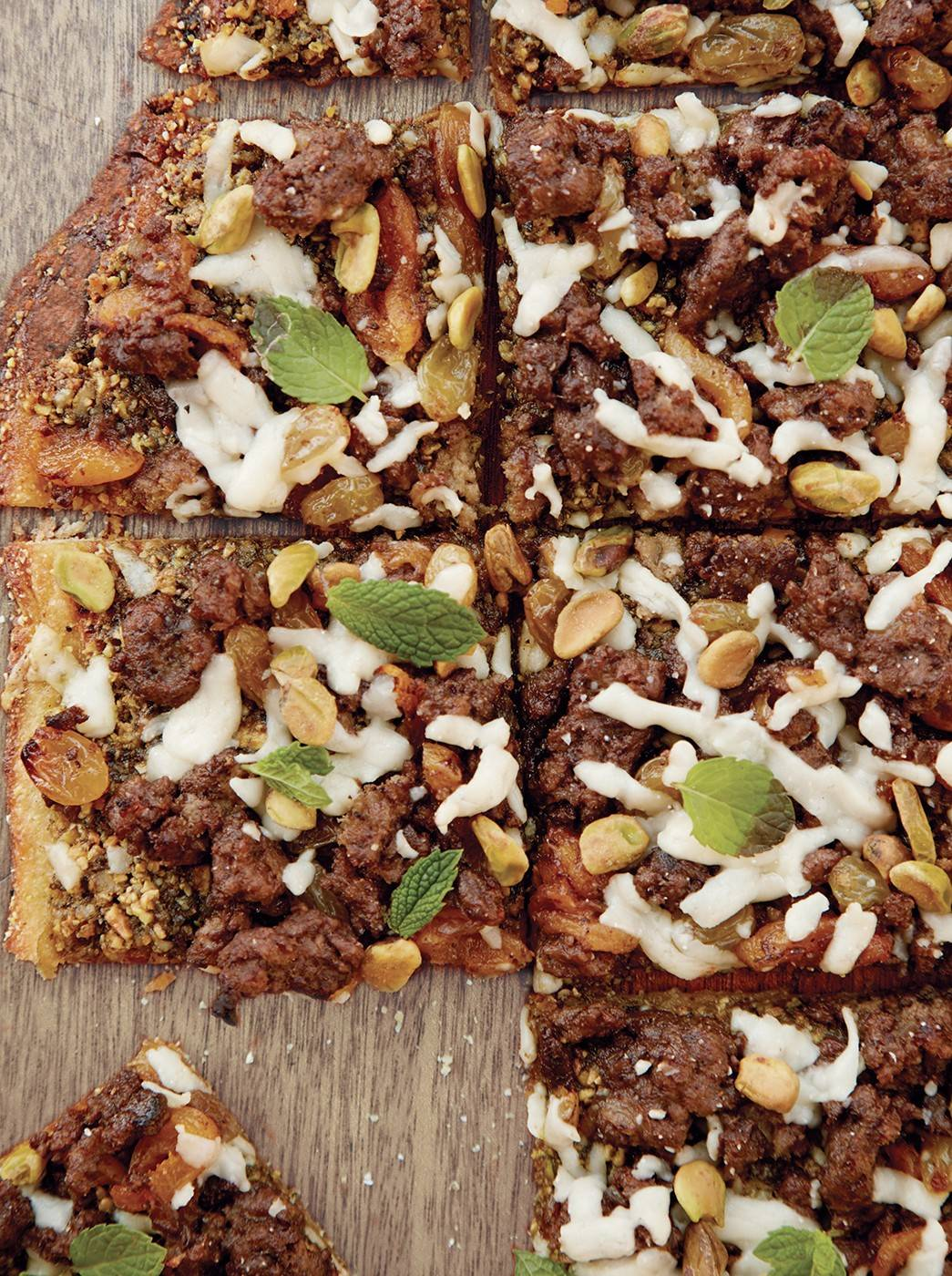 The flavors of lamb tagine come outside on this grilled pizza.