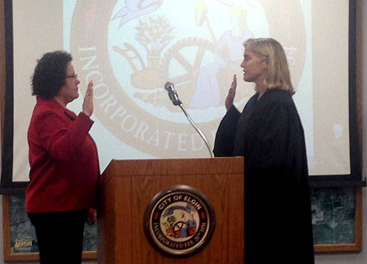 "Rosamaria ""Rose"" Martinez is sworn in as the newest member of the Elgin City Council by Kane County Associate Judge Kathy Karayannis on Wednesday night."