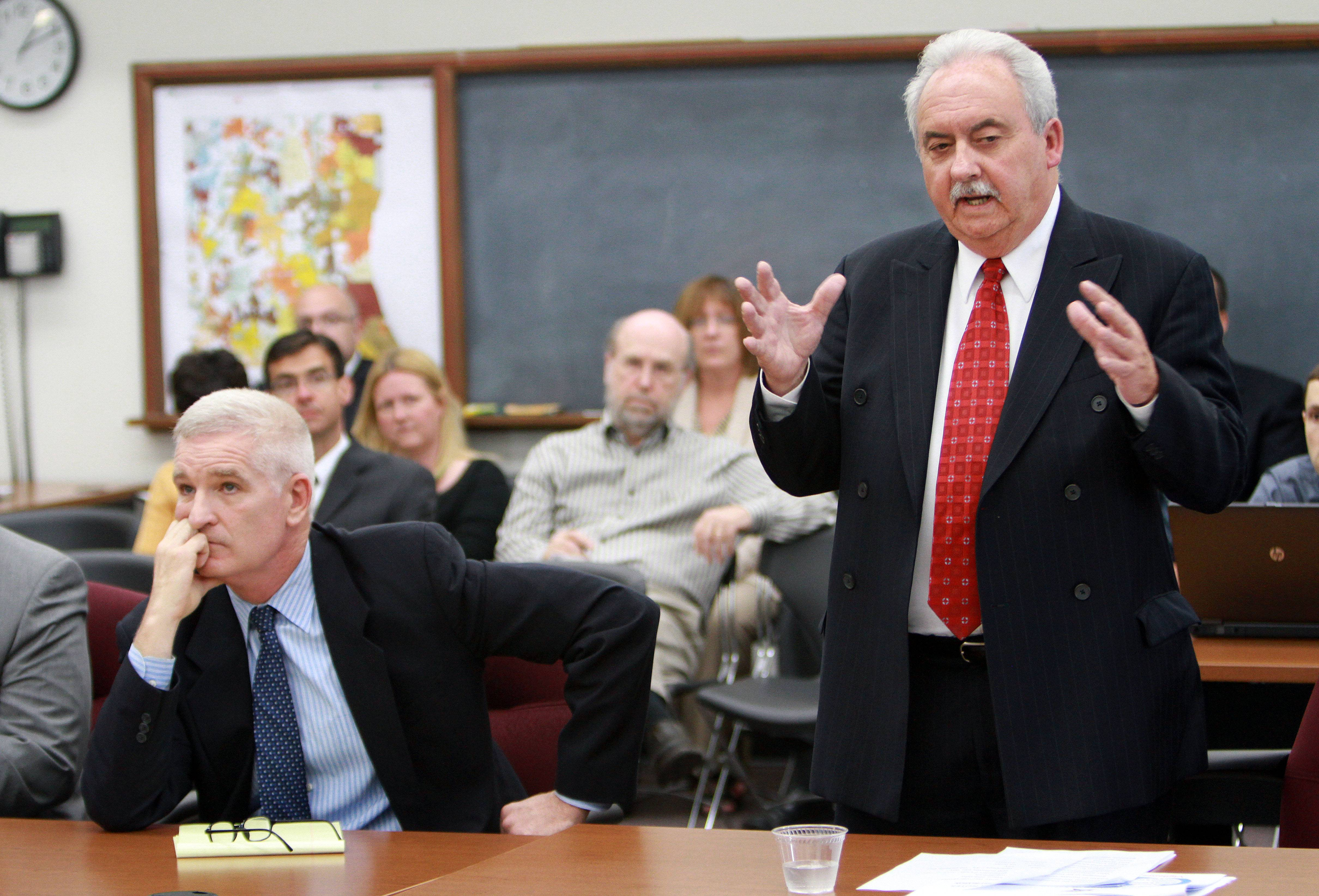 Lake County Sheriff Mark Curran, left, and Undersheriff Raymond J. Rose present a report to a Lake County Board committee Wednesday regarding the death of inmate Eugene Gruber in 2012.