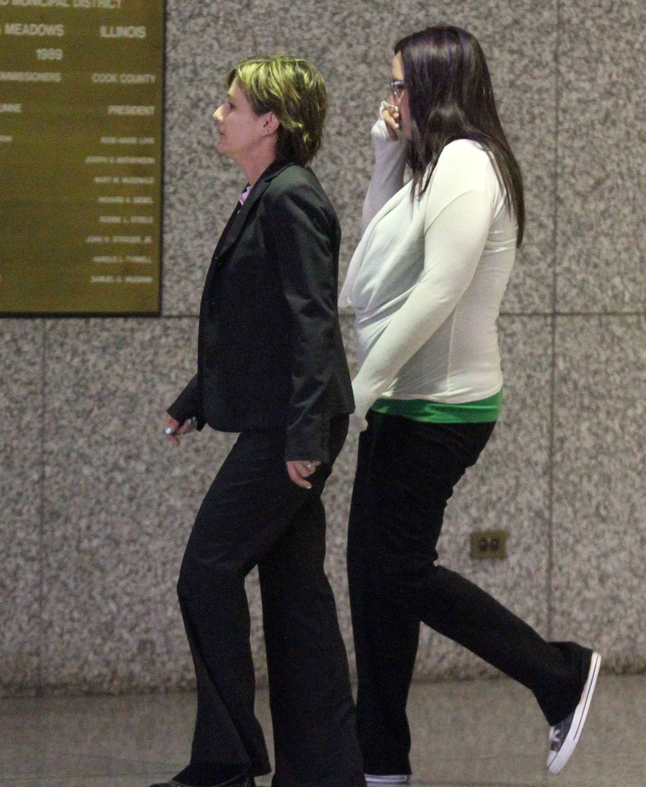 Amanda Engelhardt, Right, Arrives Wednesday At The Cook County Courthouse  In Rolling Meadow As