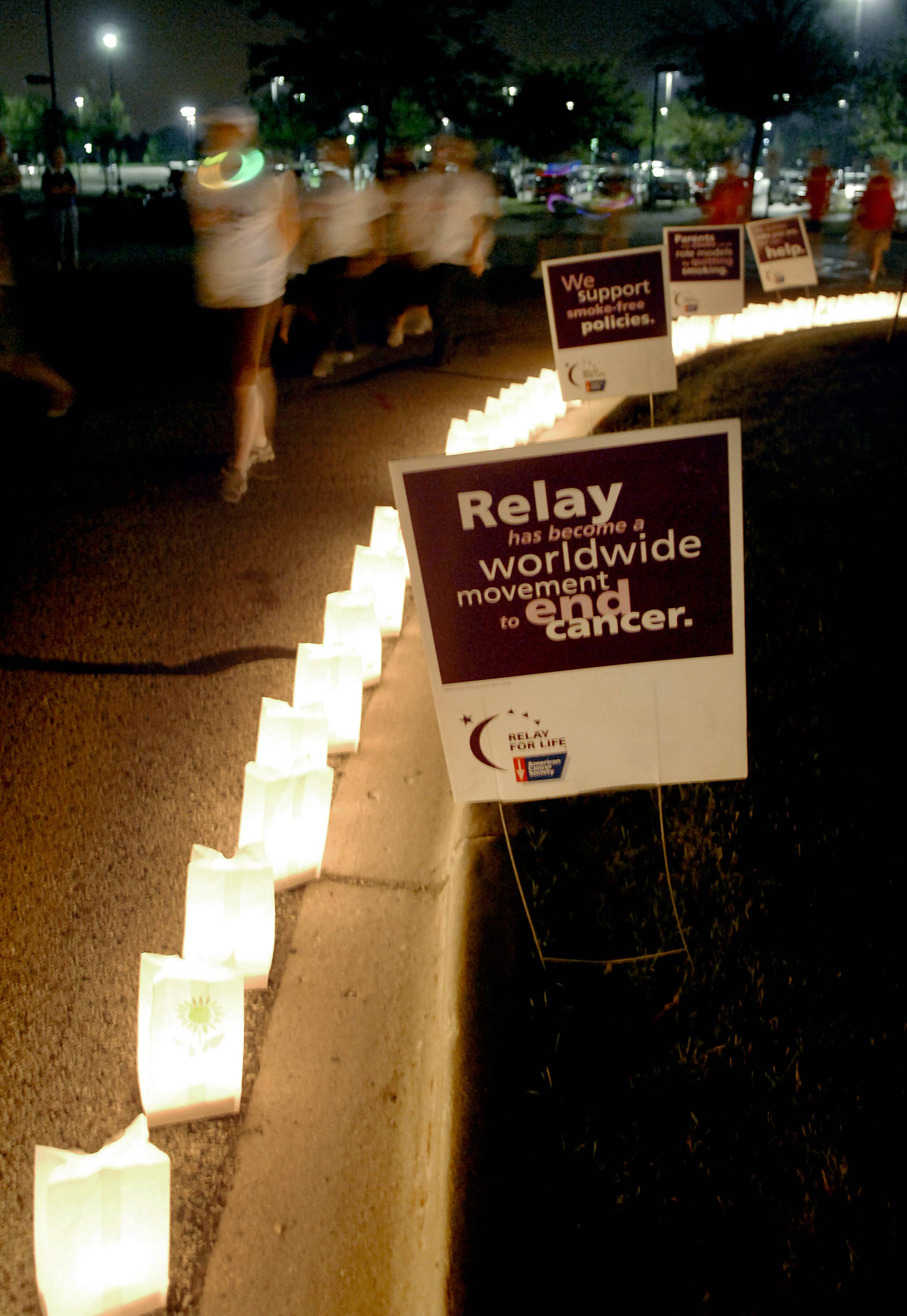 Walkers circle a line of luminarias at a previous Elgin Community College Relay For Life. This year's event is set for June 13-14.