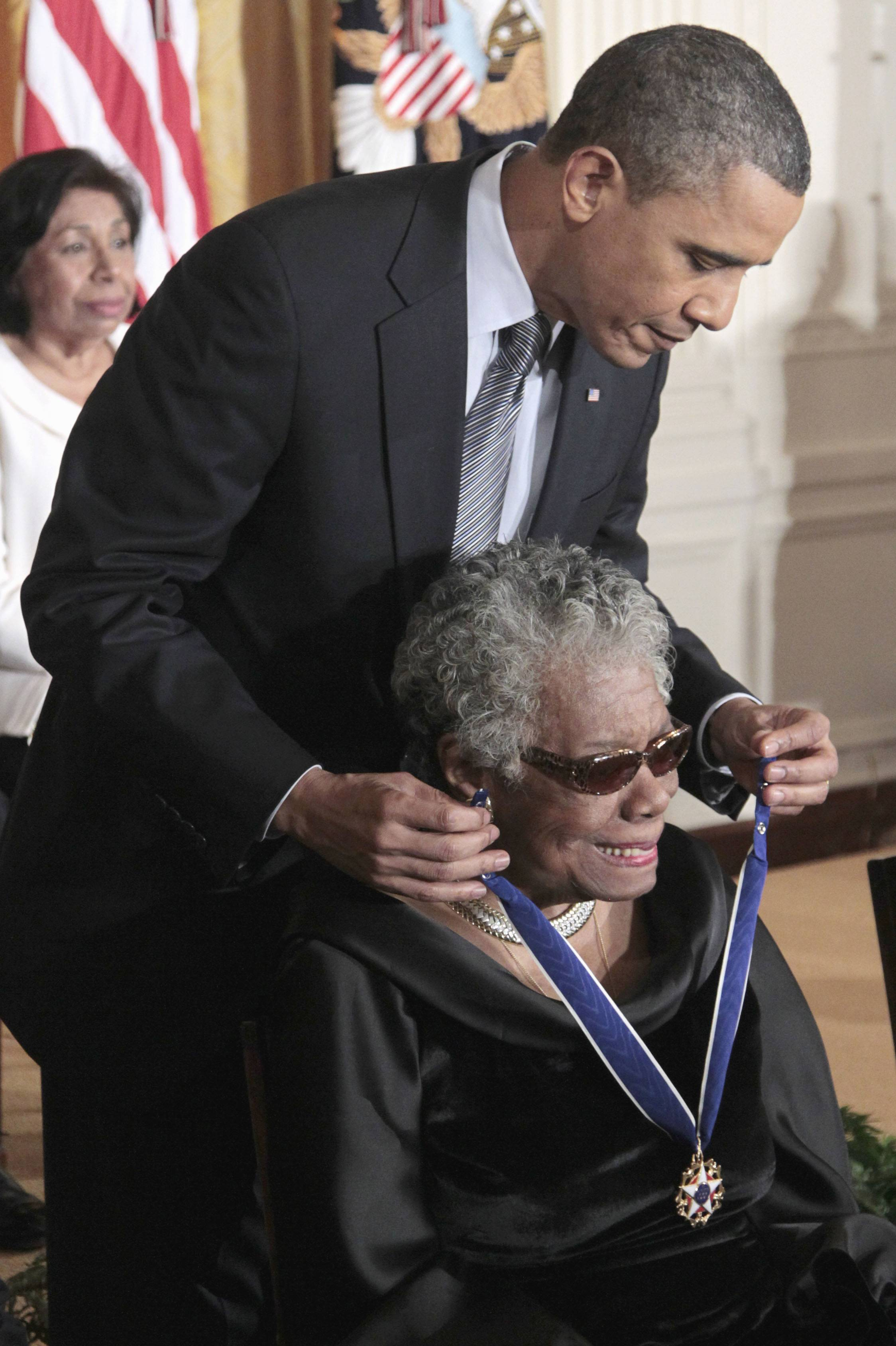 President Barack Obama presents a Presidential Medal of Freedom to author and poet Maya Angelou during a ceremony in the East Room of the White House in Washington, Tuesday, Feb. 15, 2011.