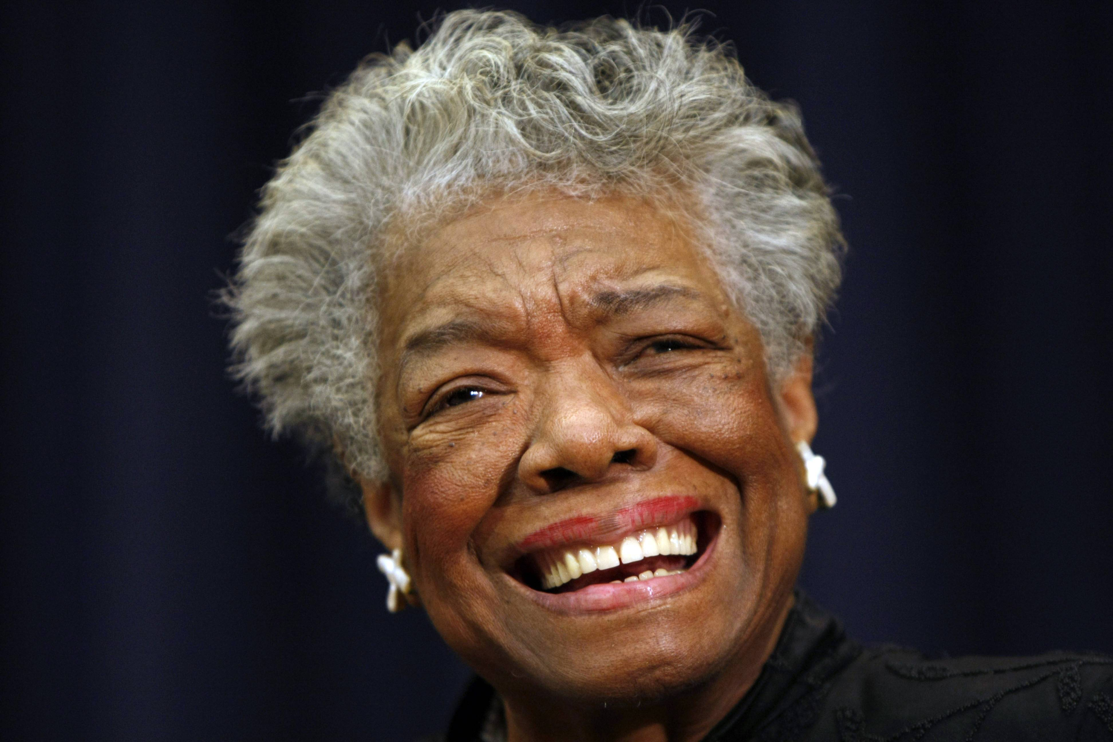 "Maya Angelou smiles at an event in Washington. Angelou, author of ""I Know Why the Caged Bird Sings,"" has died, Wake Forest University said Wednesday, May 28, 2014. She was 86."