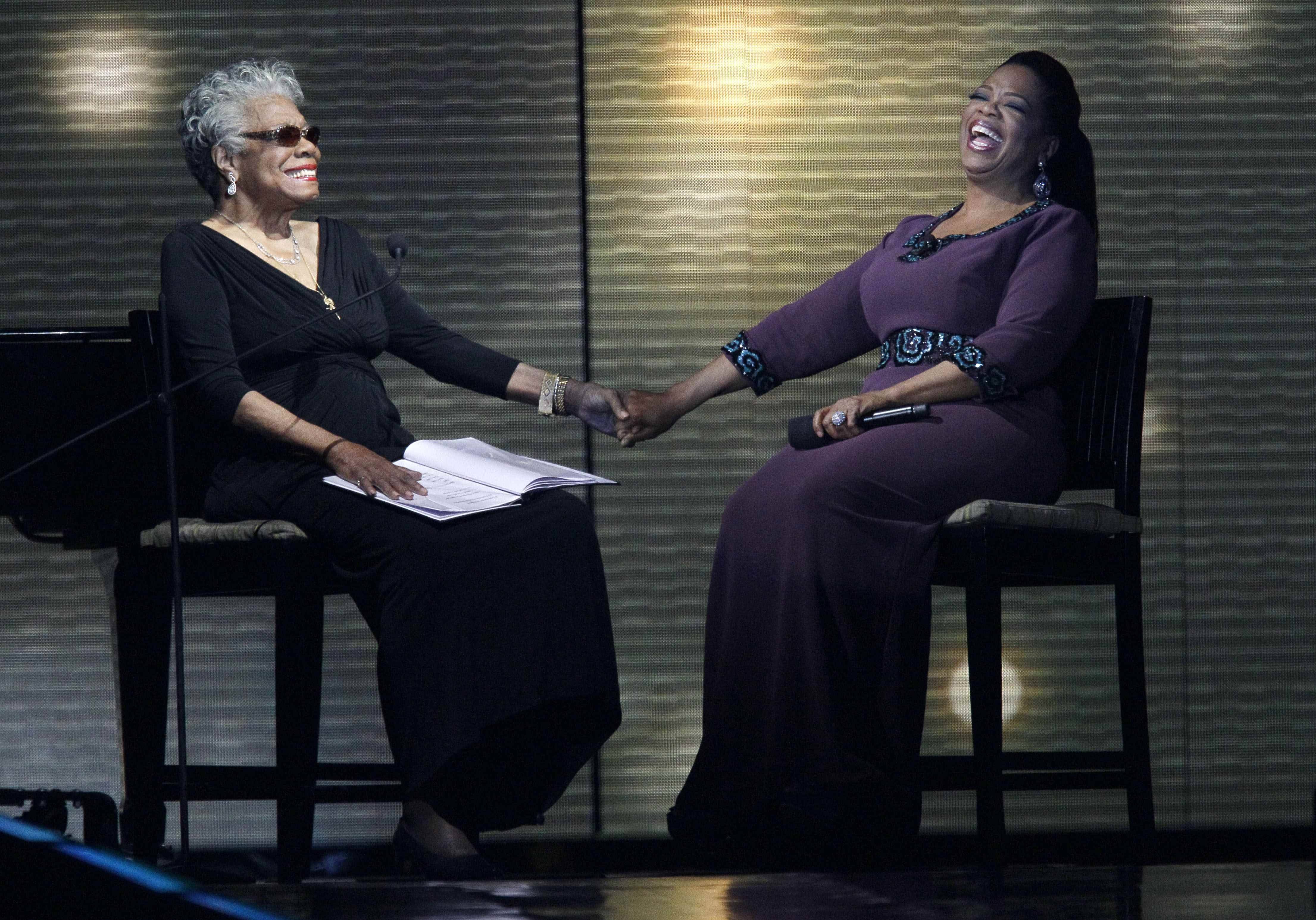 "Maya Angelou, left, and Oprah Winfrey share laughs during a star-studded double-taping of ""Surprise Oprah! A Farewell Spectacular,"" Tuesday, May 17, 2011, in Chicago. ""The Oprah Winfrey Show"" is ending its run May 25, after 25 years, and millions of her fans around the globe are waiting to see how she will close out a show that spawned a media empire."