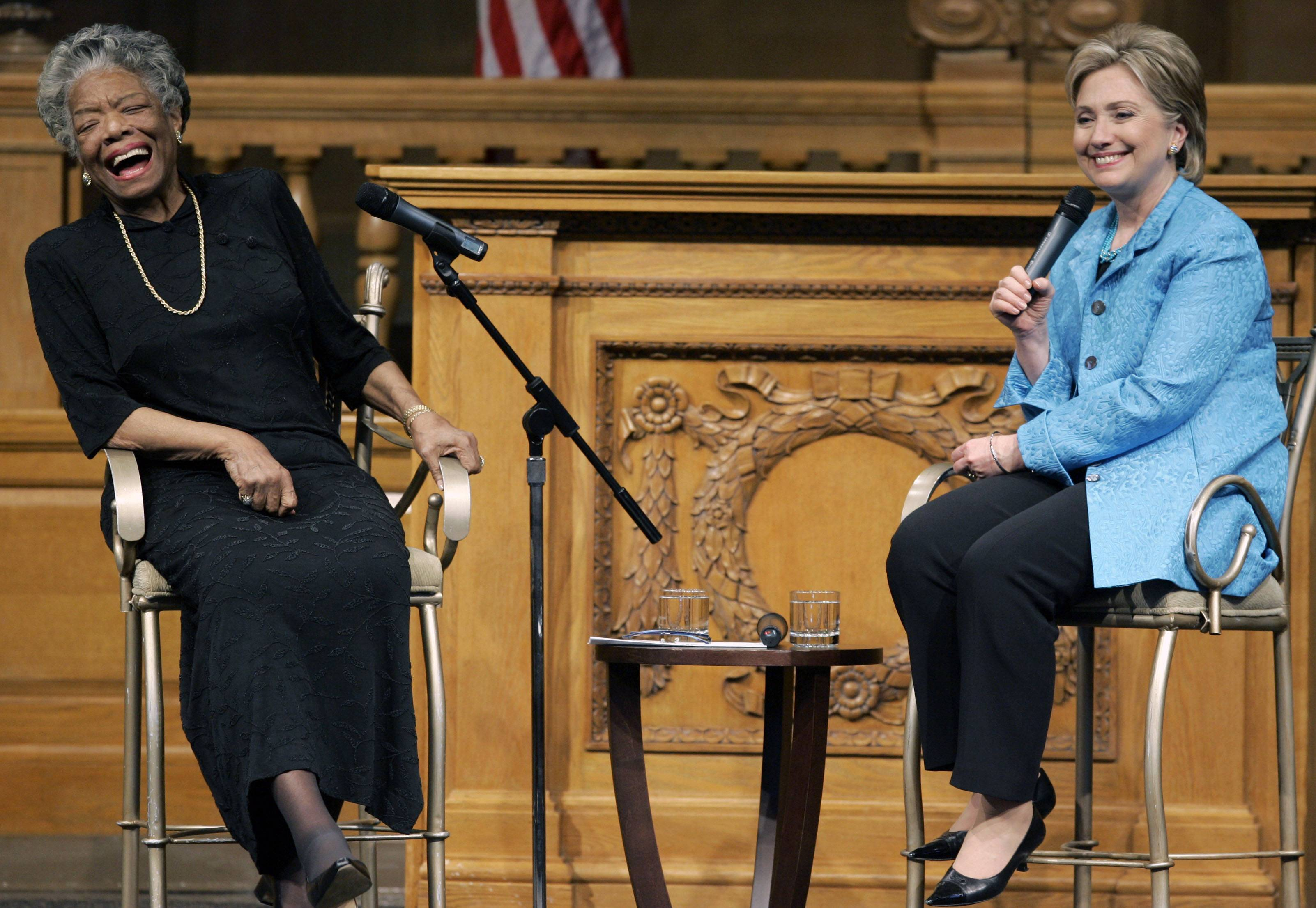 In this April 18, 2008 file photo, then U.S. Sen. Hillary Rodham Clinton, D-N.Y., right, speaks as poet Maya Angelou reacts during a campaign stop at Wake Forest University in Winston-Salem, N.C. Angelou, who rose from poverty, segregation and violence to become a force onstage, screen and the printed page, has died, Wake Forest University said Wednesday, May 28, 2014. She was 86.