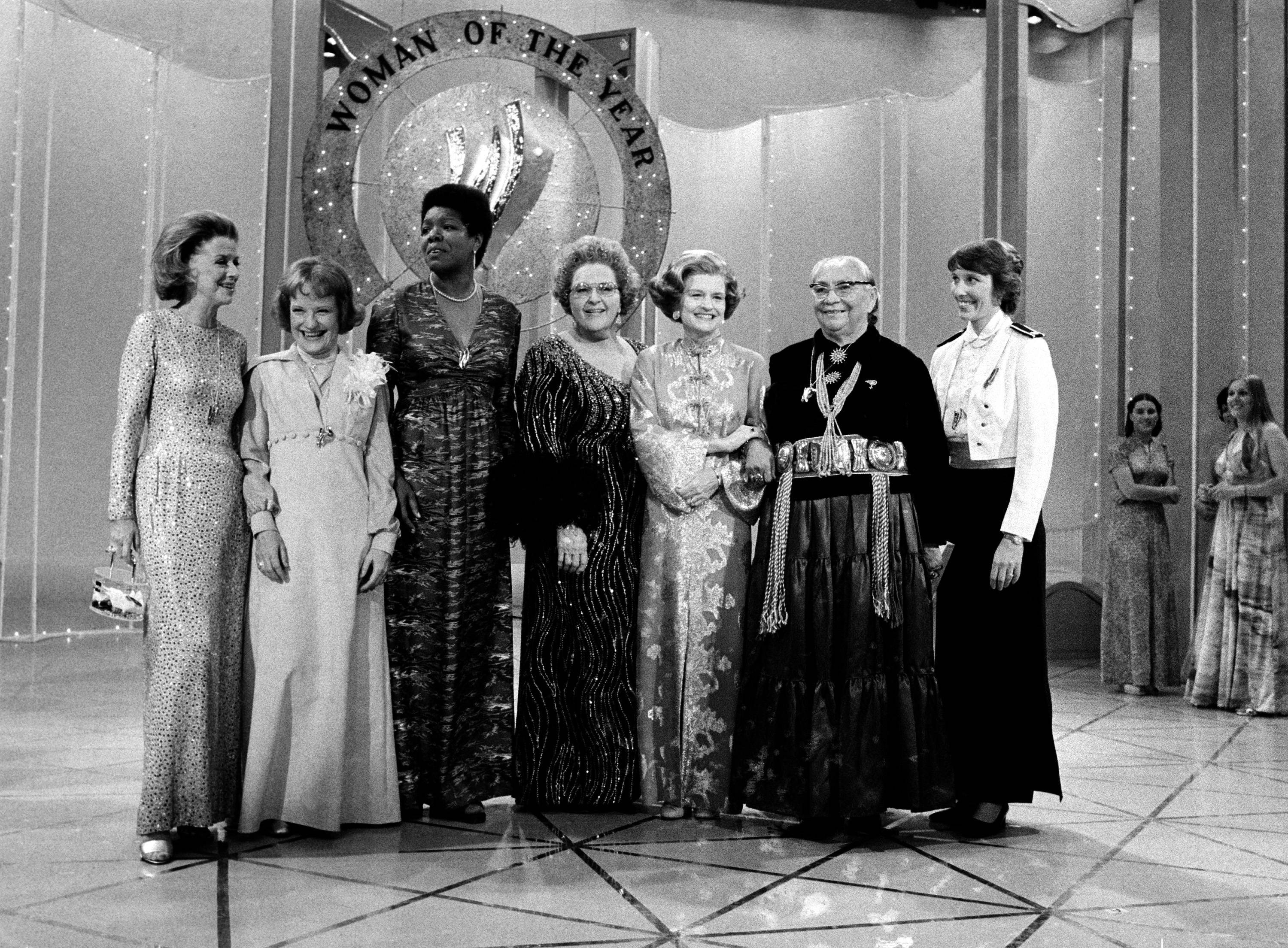 "U.S. first lady Betty Ford, third from right, poses with six other women who took part in the taping of the television special presentation of Ladies' Home Journal ""Woman of the Year 1976"" in New York City, Thursday, April 8, 1976. From left are, Betty Furness, Bettye Caldwell, Maya Angelou, singer Kate Smith, Ford, Dr. Annie D. Wauneka and Micki King."