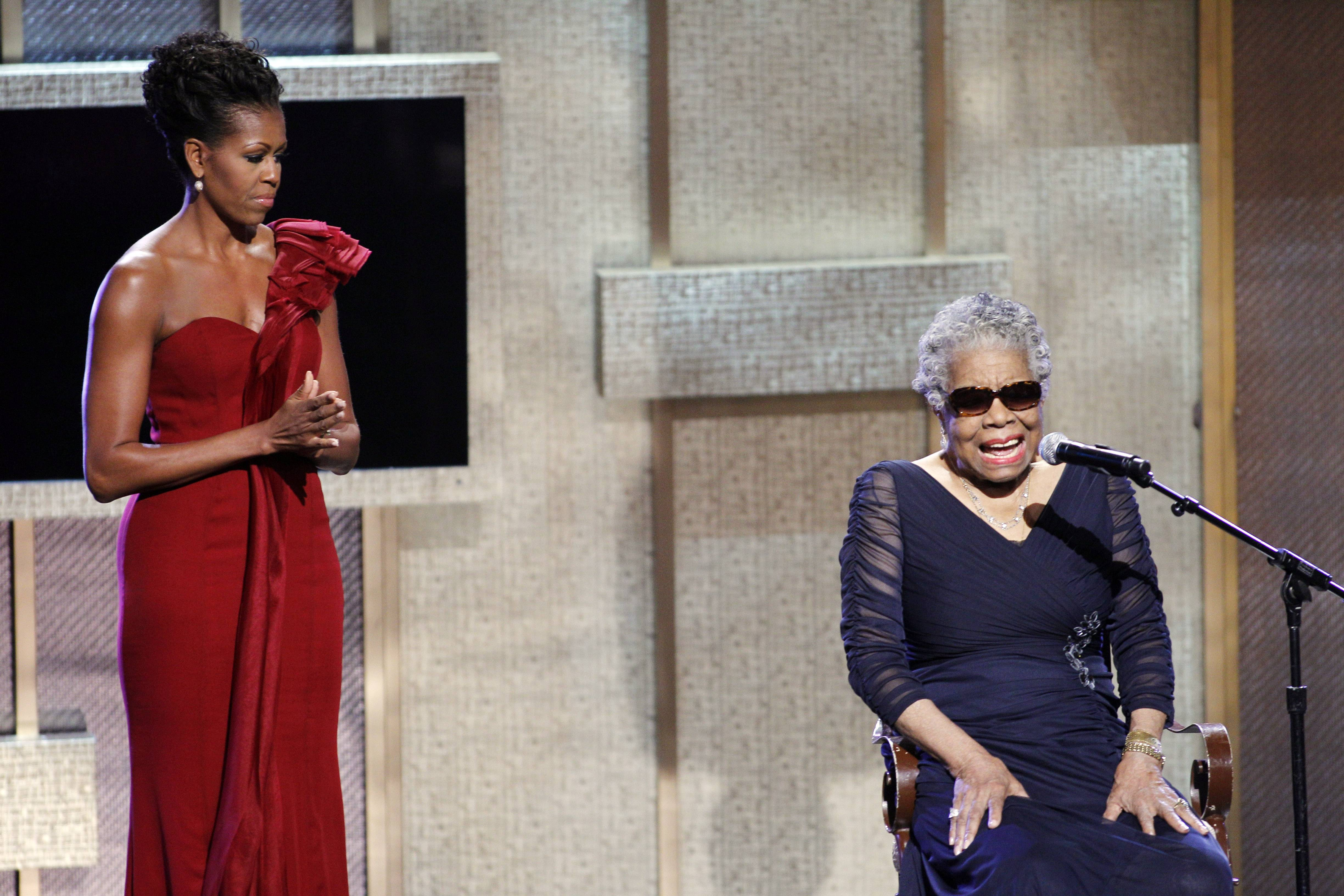 first lady Michelle Obama listens while BET honoree Maya Angelou speaks during the BET Honors after receiving the Literary Arts Award, at the Warner Theatre in Washington on Saturday, Jan. 14, 2012.