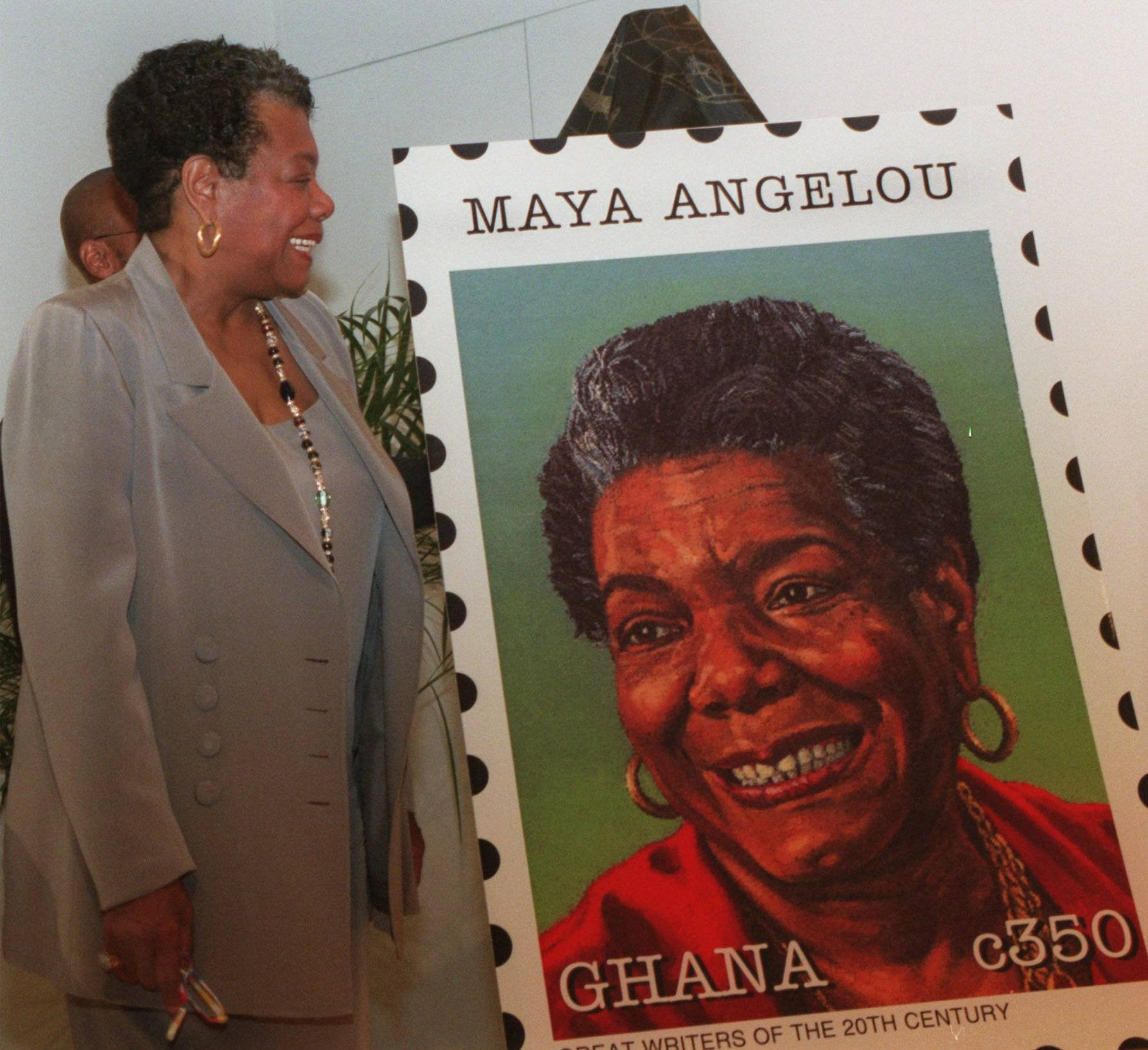 Author Maya Angelou admires a blowup a of a Ghana postage stamp in her honor during a ceremony in Washington Thursday Nov. 13,1997. Twelve Black authors were honored on stamps from Ghana and Uganda to promote World Literacy. The stamps were designed by Gary Aagaard of Seattle.