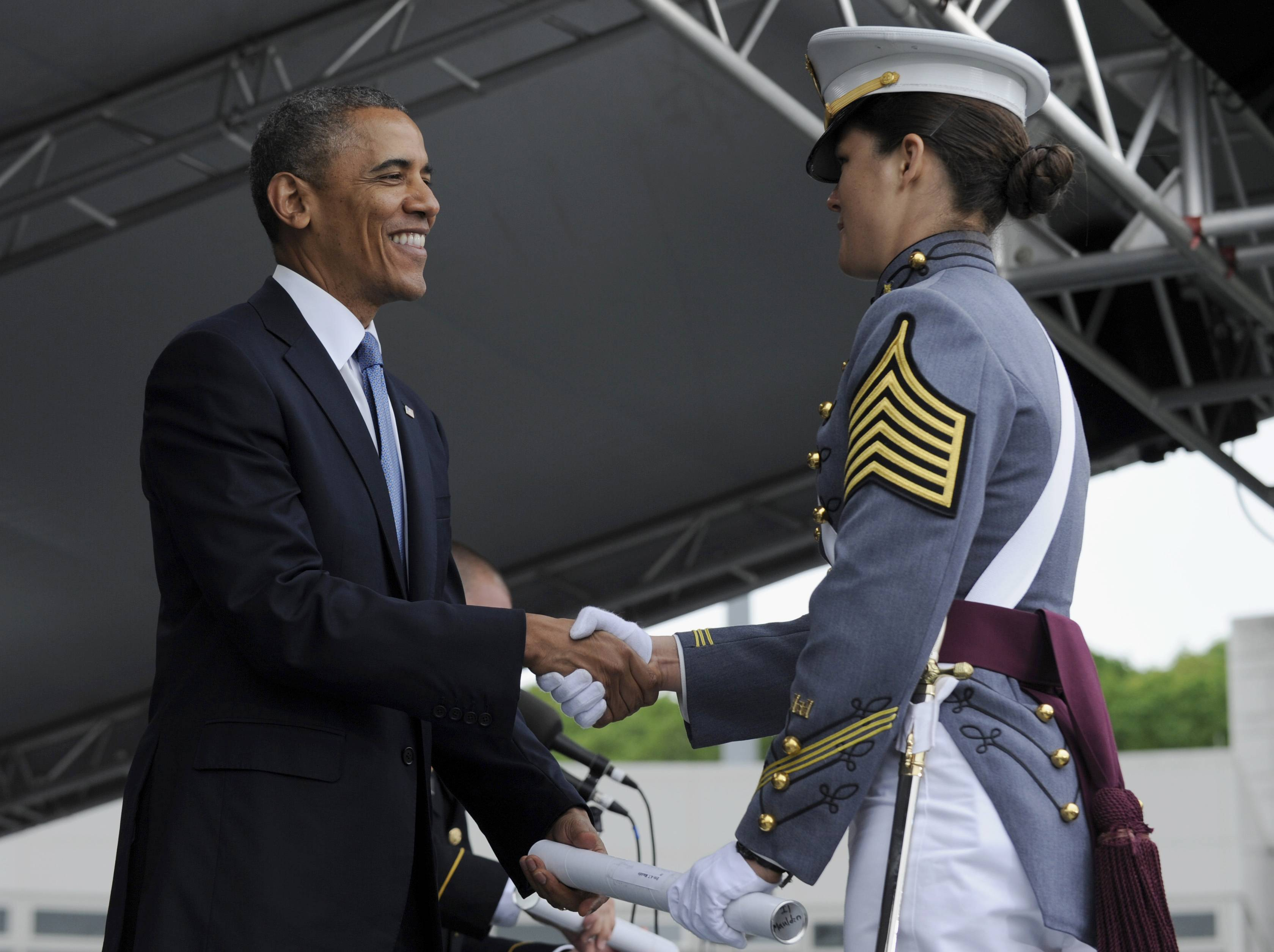 President Barack Obama hands out diploma to class valedictorian Erin Maudlin from Albuquerque, N.M., during the commencement ceremony for the U.S. Military Academy at West Point's Class of 2014, in West Point, N.Y., Wednesday, May 28, 2014.