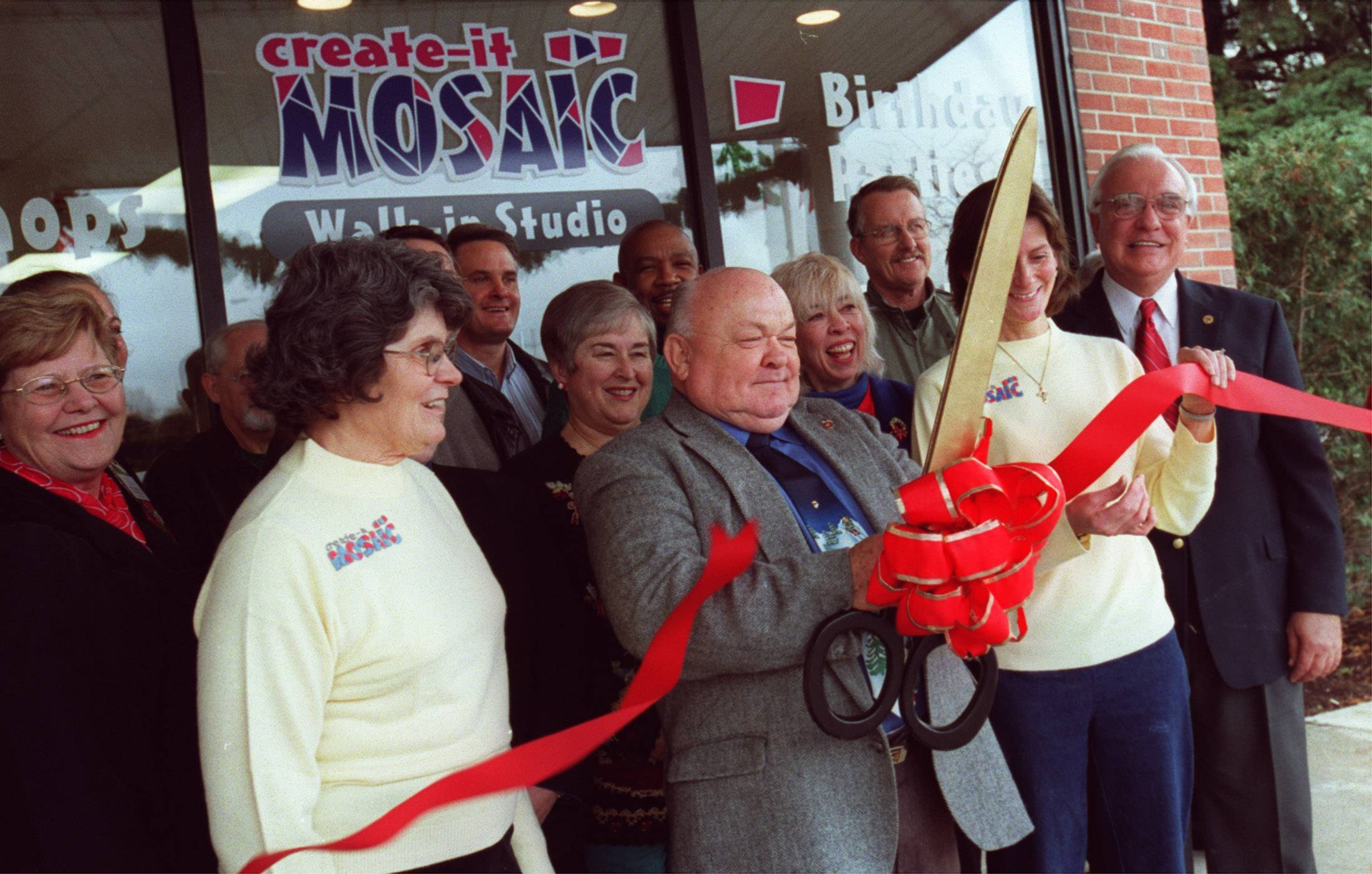 During all his nearly 20 years as Naperville mayor, George Pradel has been known to make time for ribbon cuttings at new businesses, such as this event in December 2003 at Create-a-Mosaic.