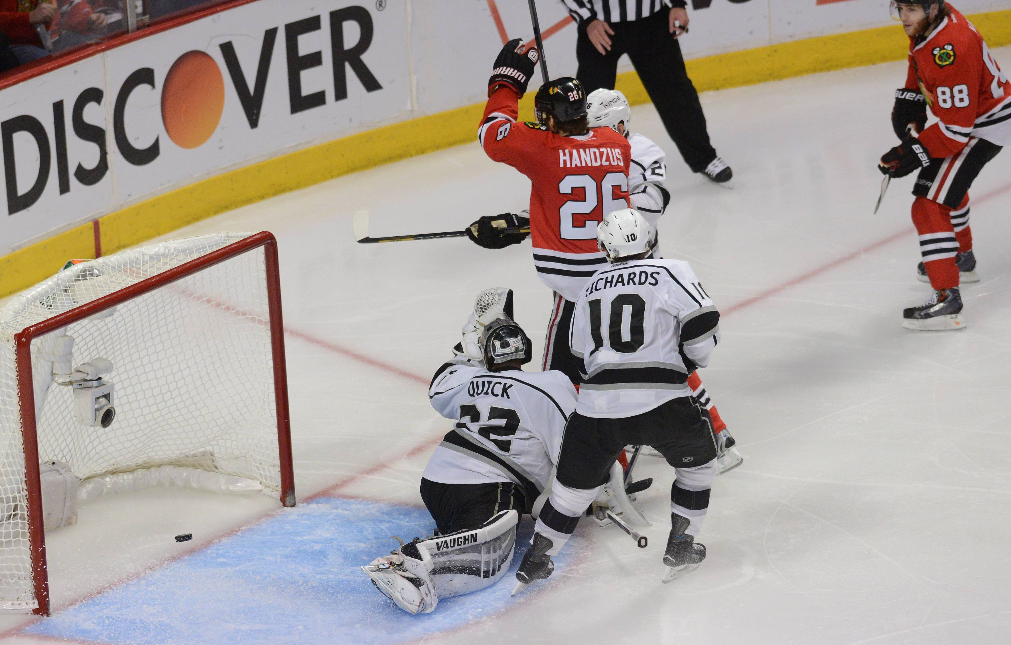 Blackhawks center Michal Handzus scores the game-winning goal in double overtime Wednesday night in Game 5 of the Western Conference finals at the United Center.
