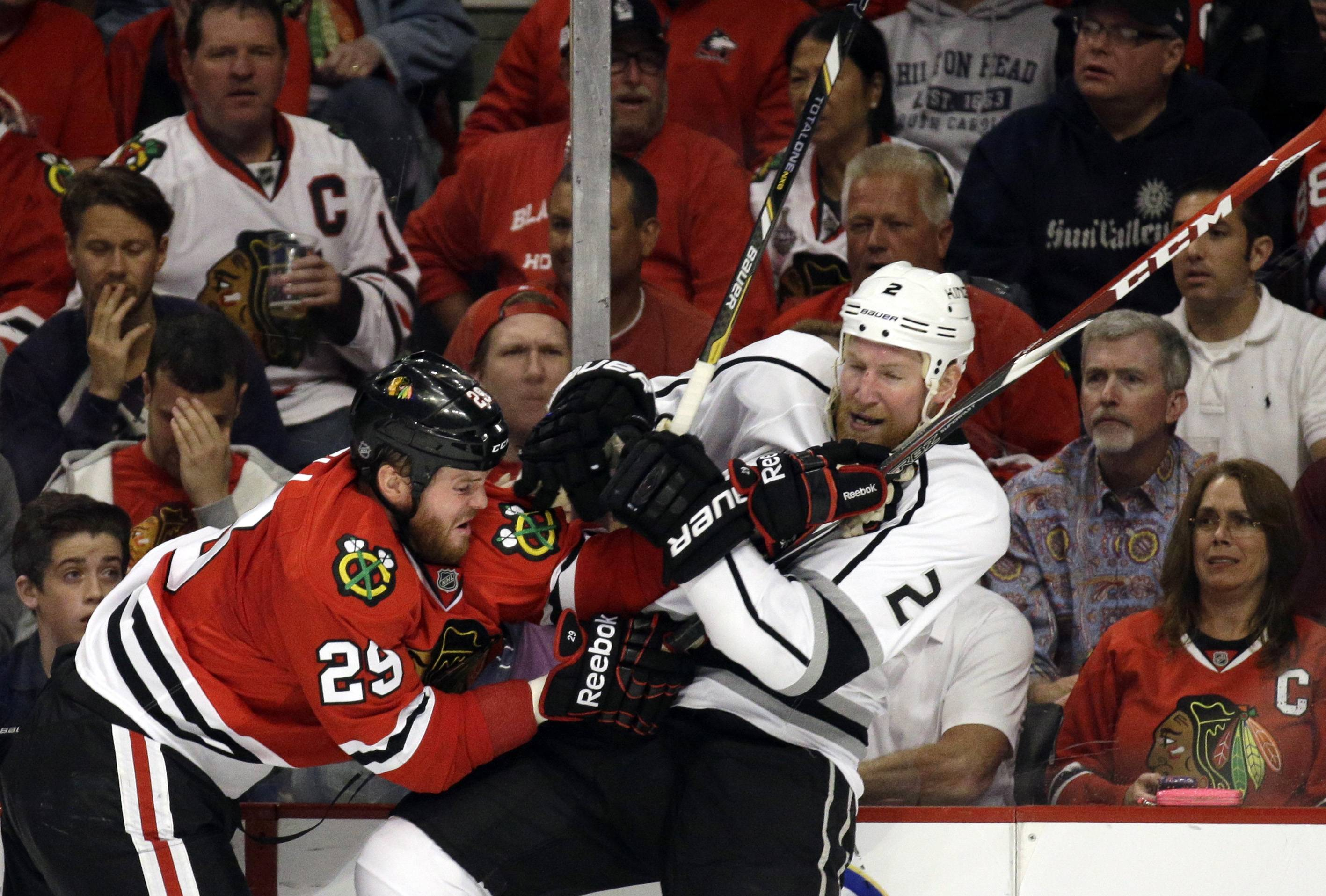 Chicago Blackhawks left wing Bryan Bickell (29) checks Los Angeles Kings defenseman Matt Greene (2) during the second period.