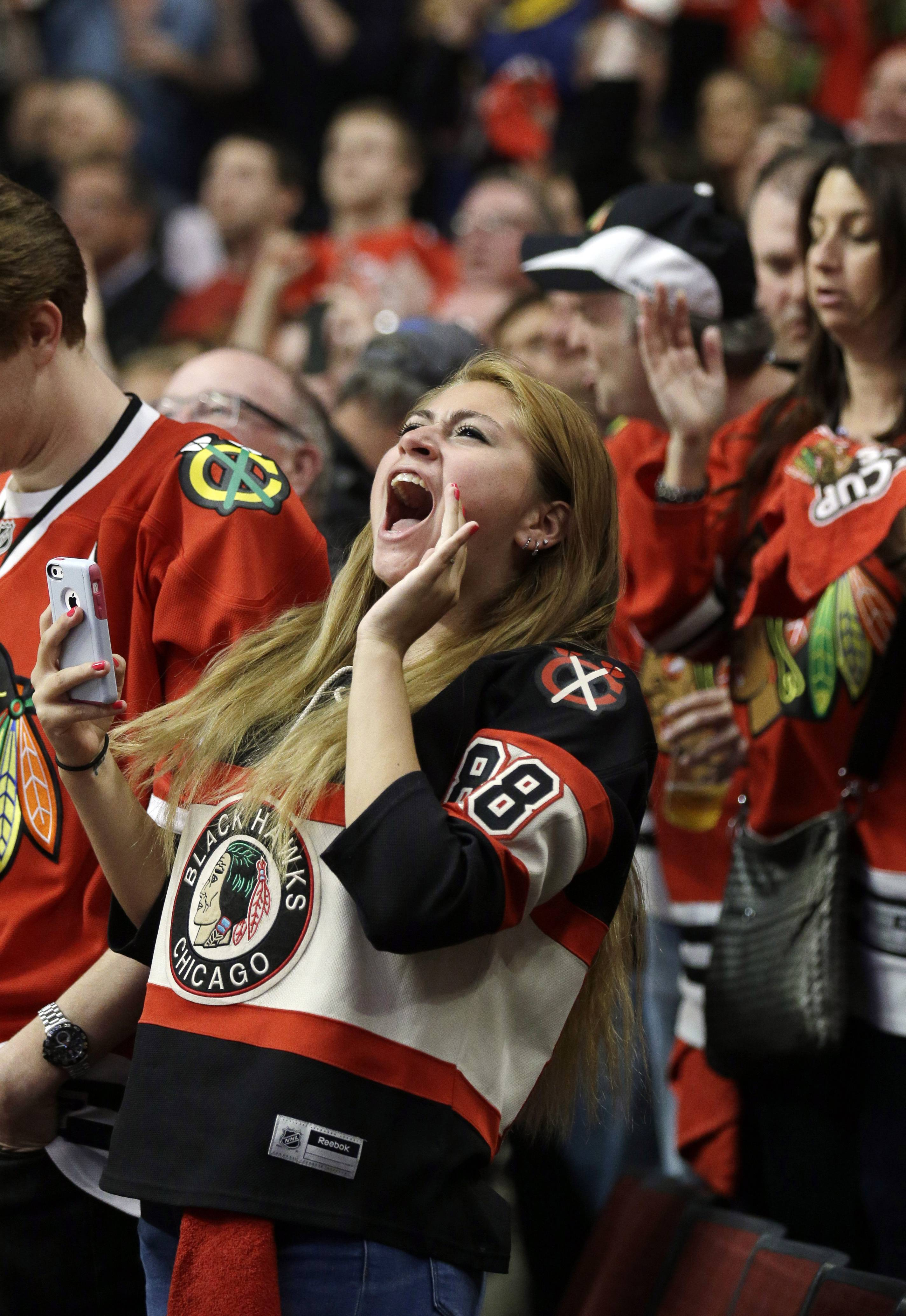 Fans cheer after Chicago Blackhawks defenseman Johnny Oduya scores a goal against the Los Angeles Kings during the first period.