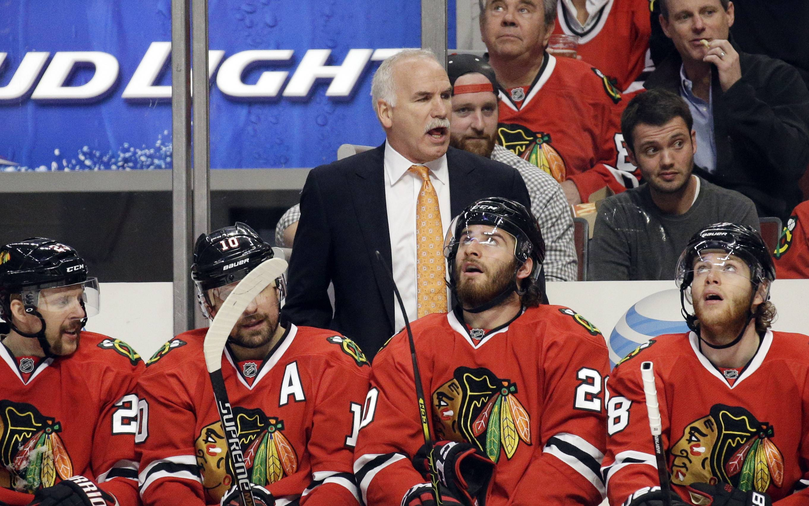 Chicago Blackhawks head coach Joel Quenneville directs his team during the second period.