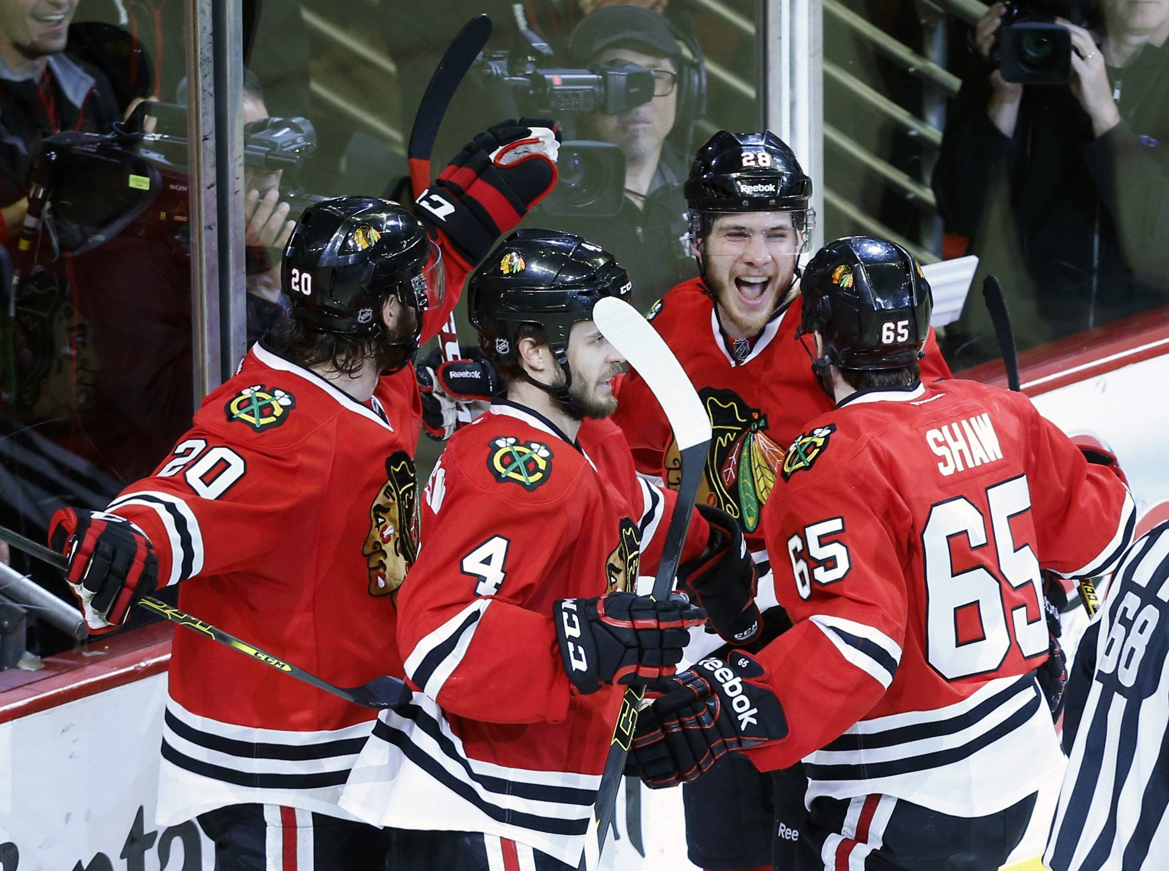Chicago Blackhawks right wing Ben Smith, second from right, celebrates with his teammates after scoring a goal against Los Angeles Kings during the third period.