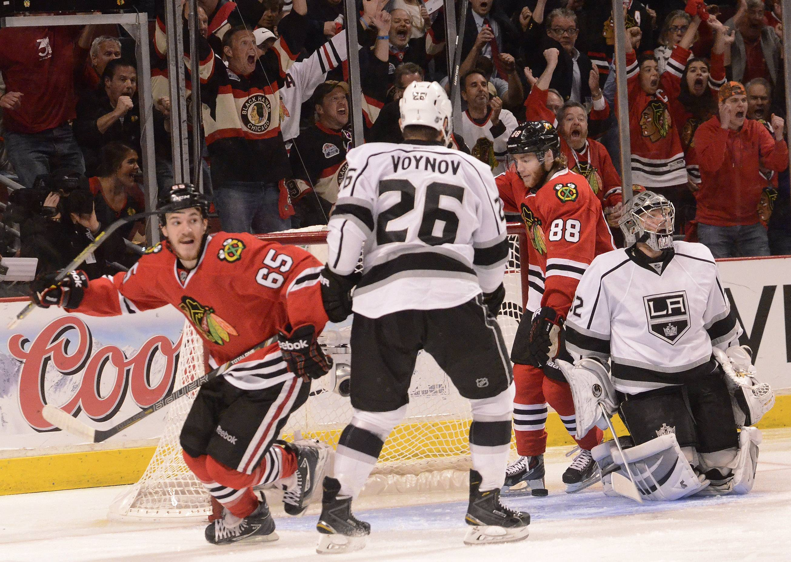 Chicago Blackhawks center Andrew Shaw and Chicago Blackhawks right wing Patrick Kane react to Chicago Blackhawks defenseman Brent Seabrook's first-period goal.