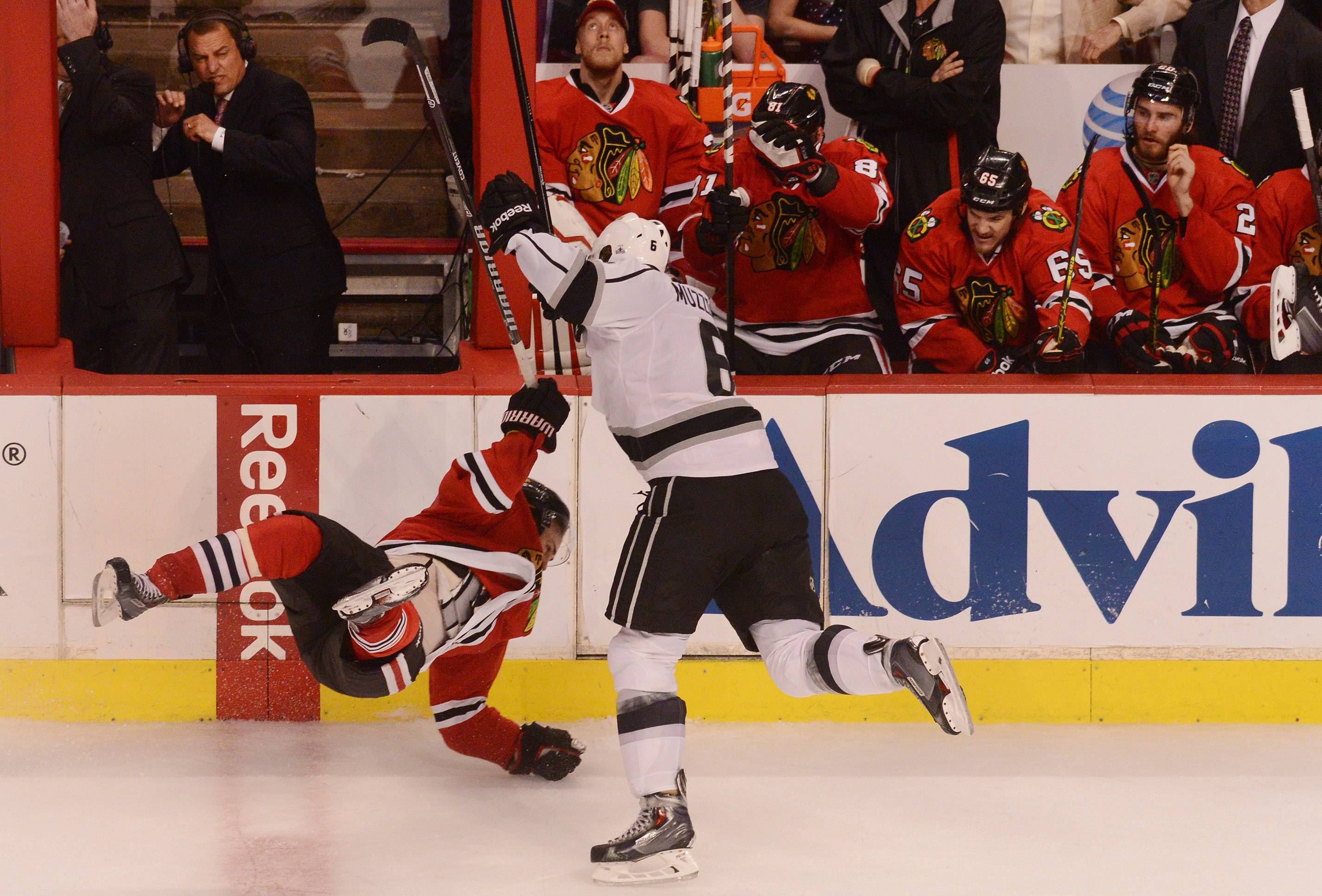 Chicago Blackhawks center Marcus Kruger gets hit by Los Angeles Kings defenseman Jake Muzzin in the third period.
