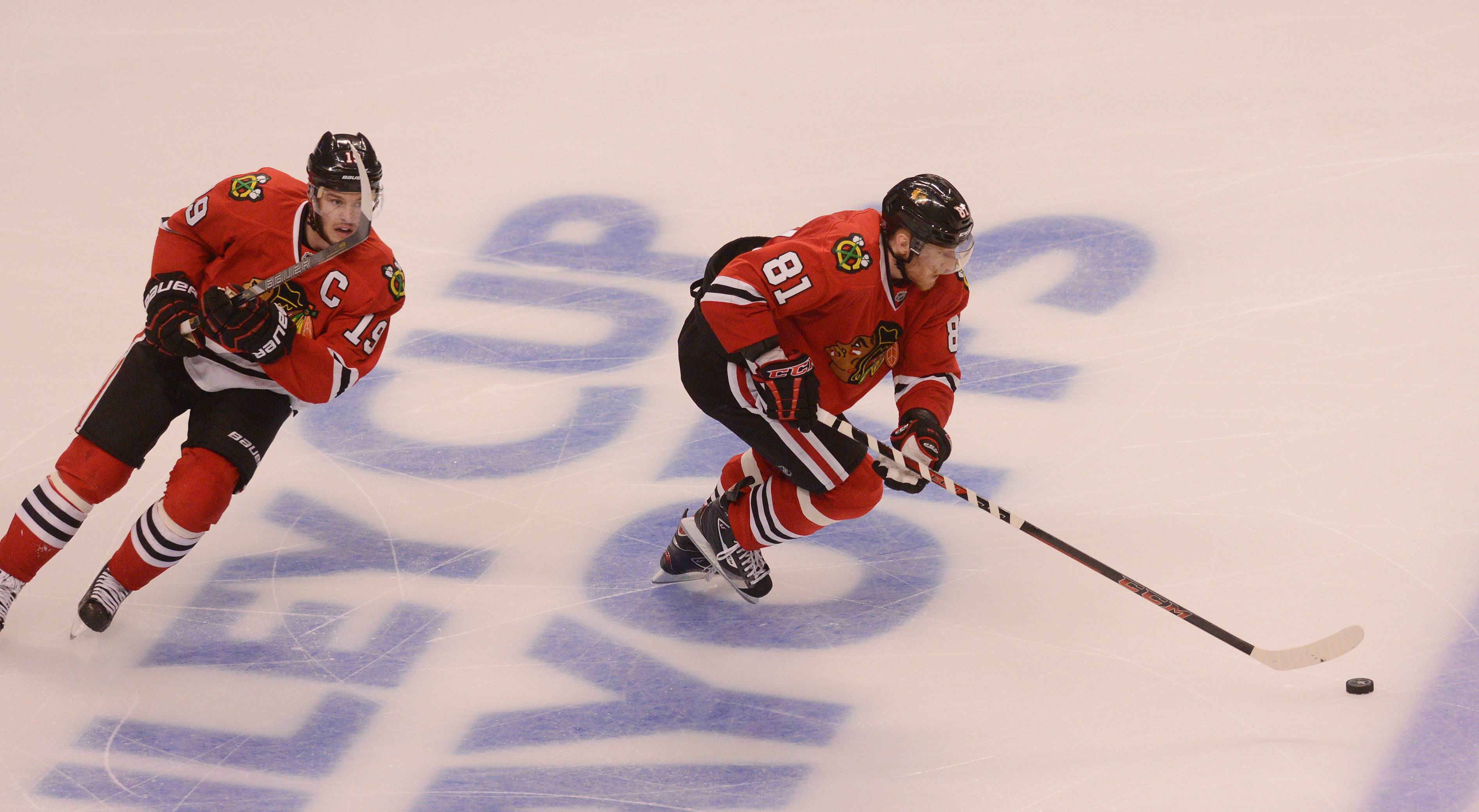 Hossa and Toews make their way up ice in the first OT period.