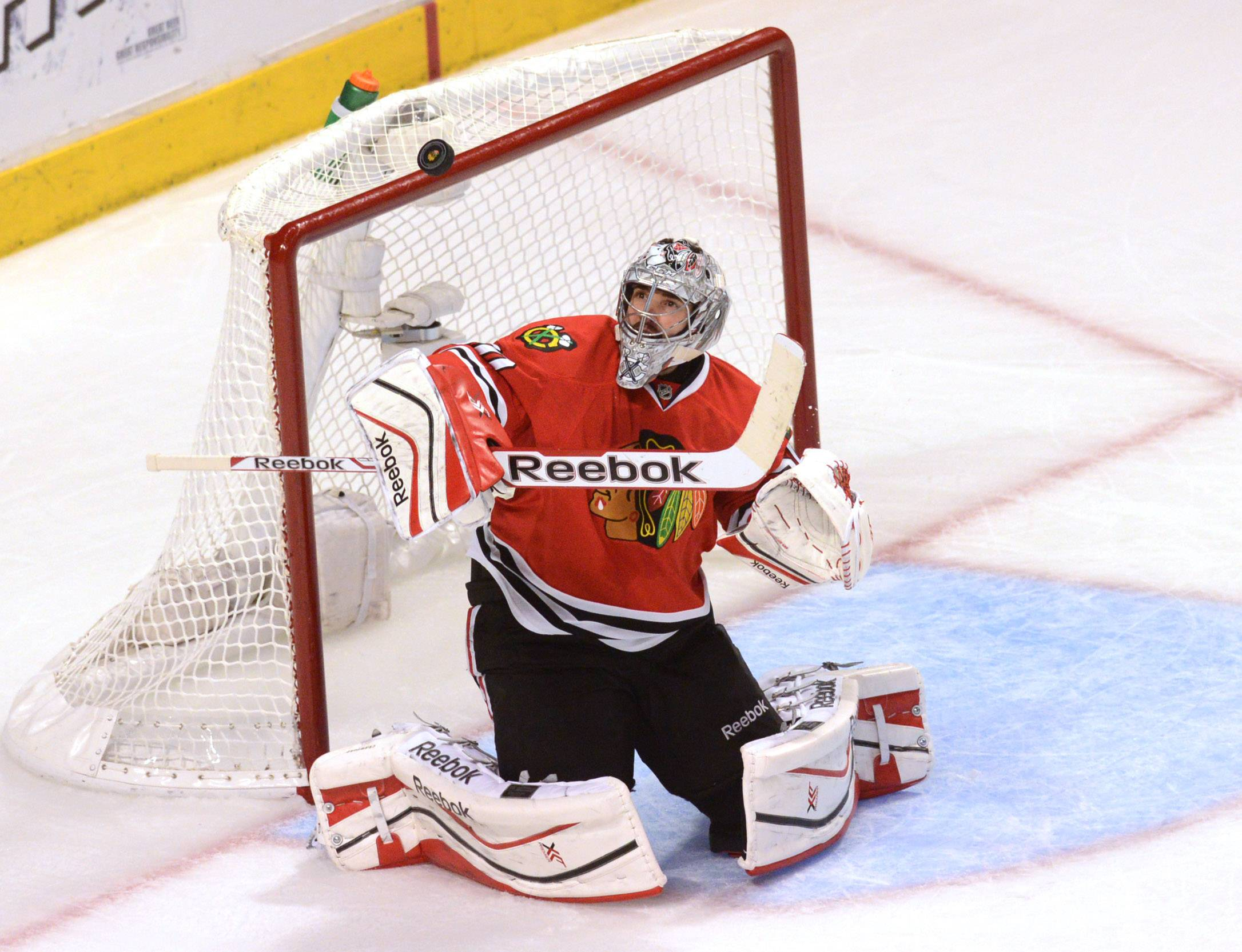 Chicago Blackhawks goalie Corey Crawford makes a save in the first OT.