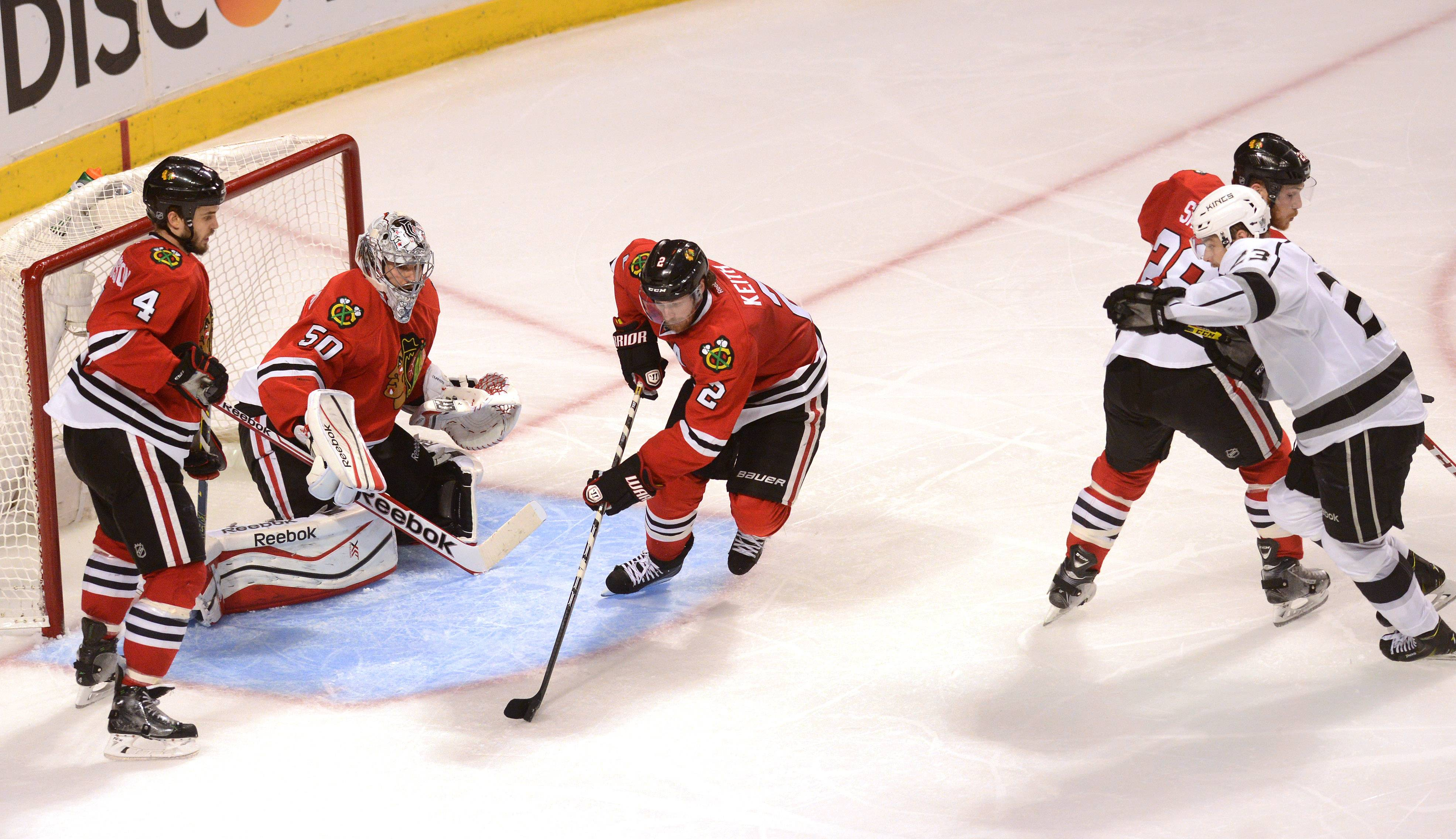 Chicago Blackhawks defenseman Duncan Keith scoops up a loose puck in front of his own net in the first OT.