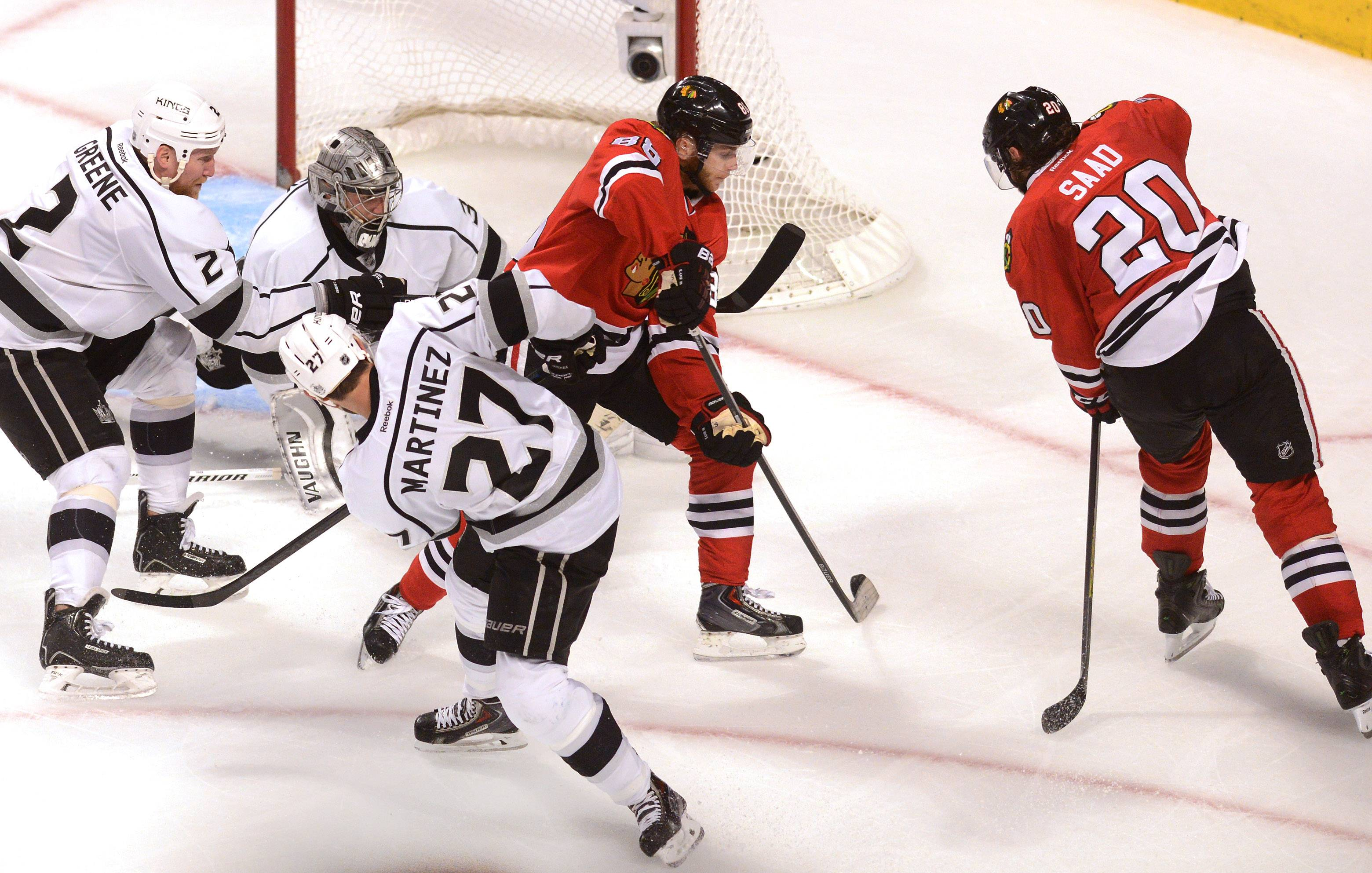 Chicago Blackhawks right wing Patrick Kane and Chicago Blackhawks left wing Brandon Saad try to score in the first OT.