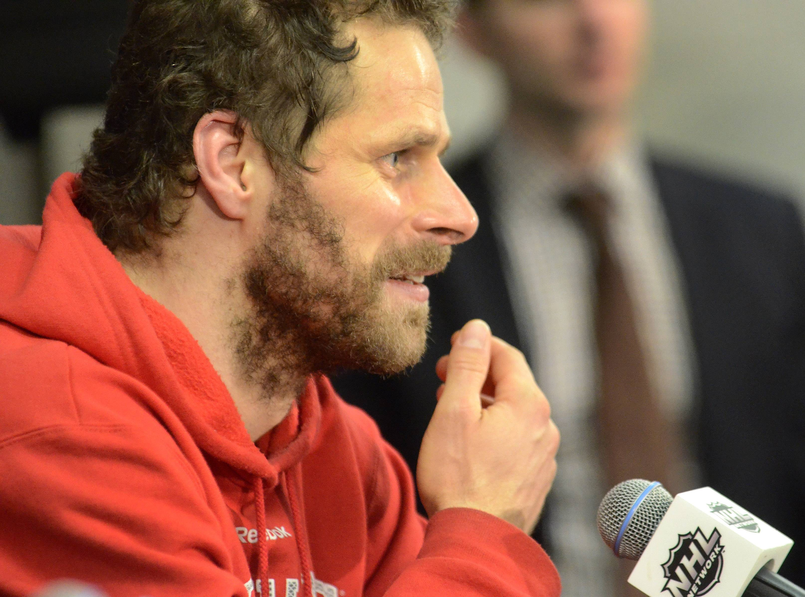 A happy Chicago Blackhawks center Michal Handzus speaks in the post-game press conference.