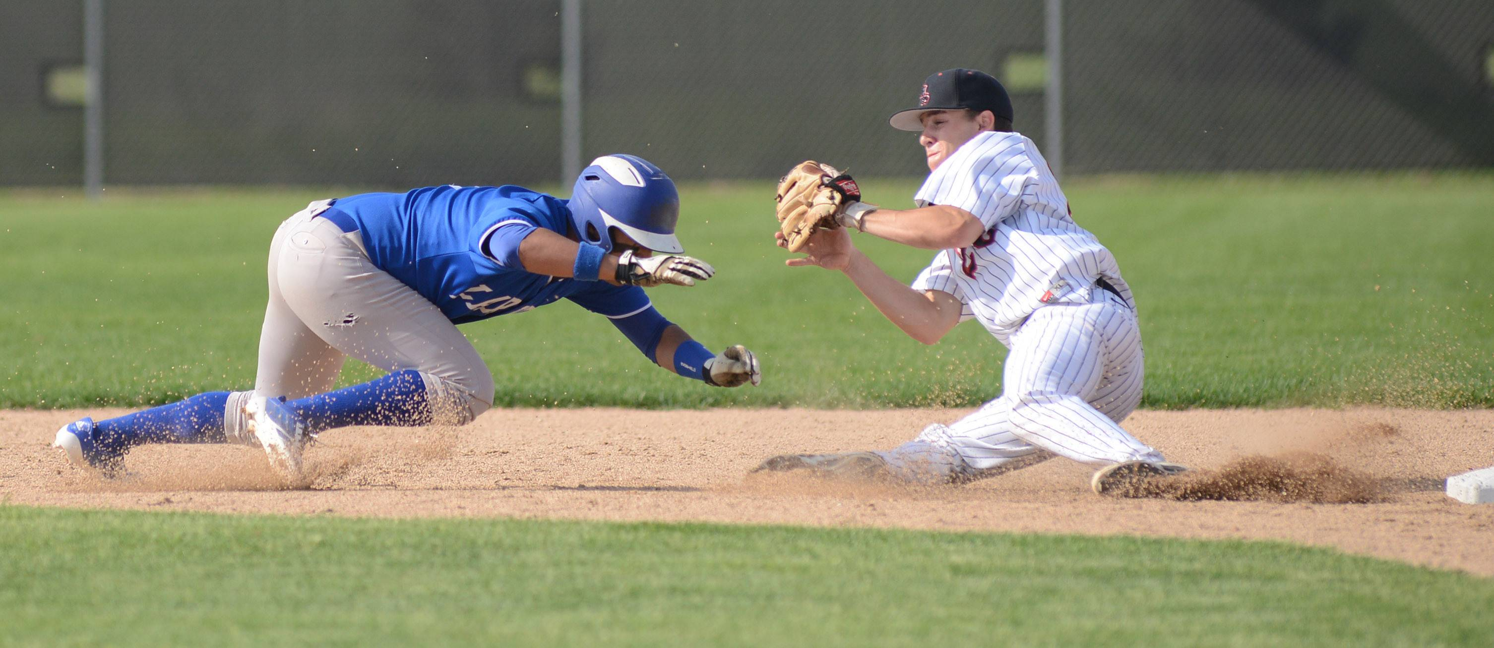 Larkin's Jonathan Avila, left, and Huntley's Matt Sullivan slide towards each other resulting in Avila being tagged out as he scrambles back to second base in the fifth inning of the Class 4A regional semifinals at DeKalb High School on Wednesday, May 28.