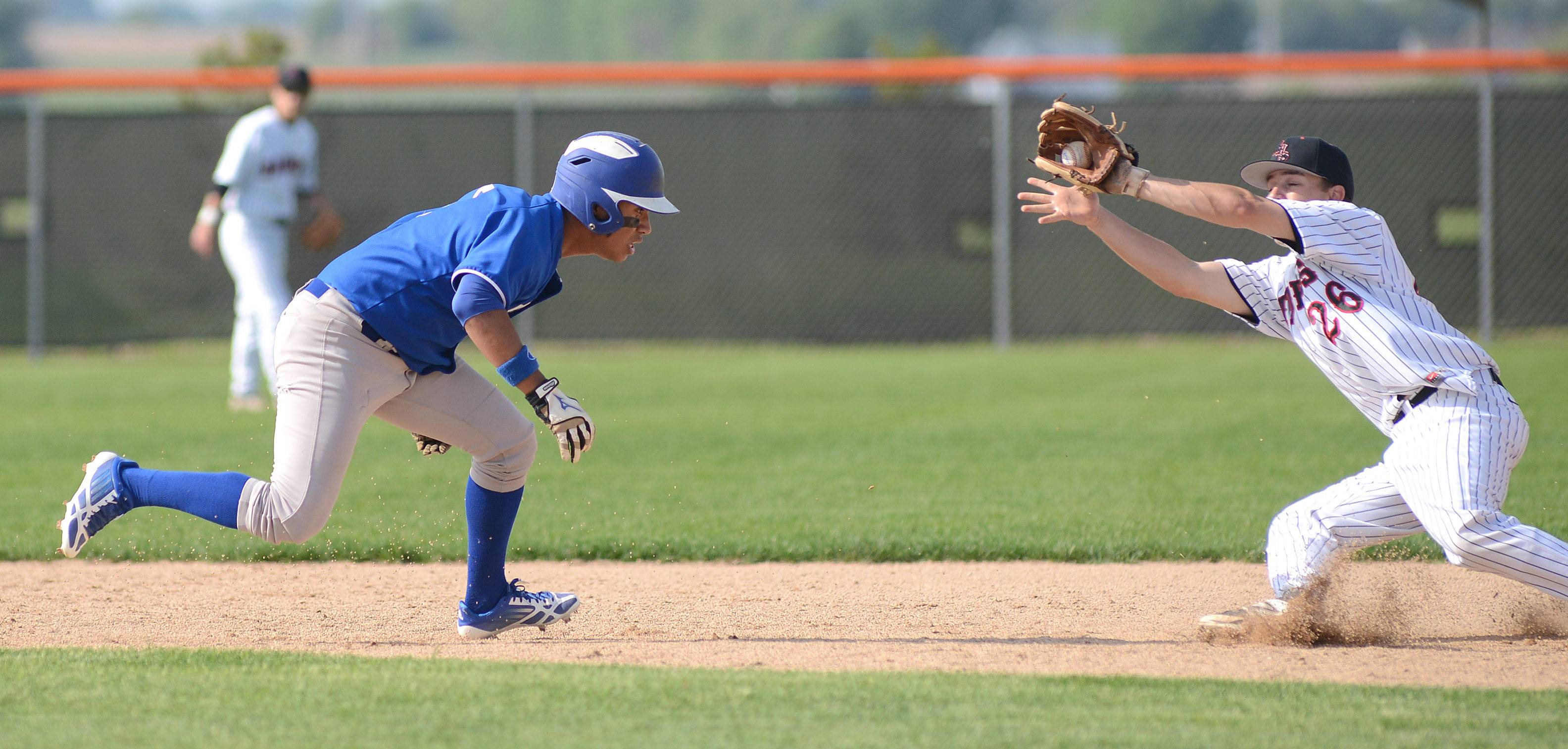 Larkin's Jonathan Avila, left, and Huntley's Matt Sullivan slide towards each other with Avila being tagged out as he scrambles back to second base in the with inning of the Class 4A regional semifinals at DeKalb High School on Wednesday, May 28.