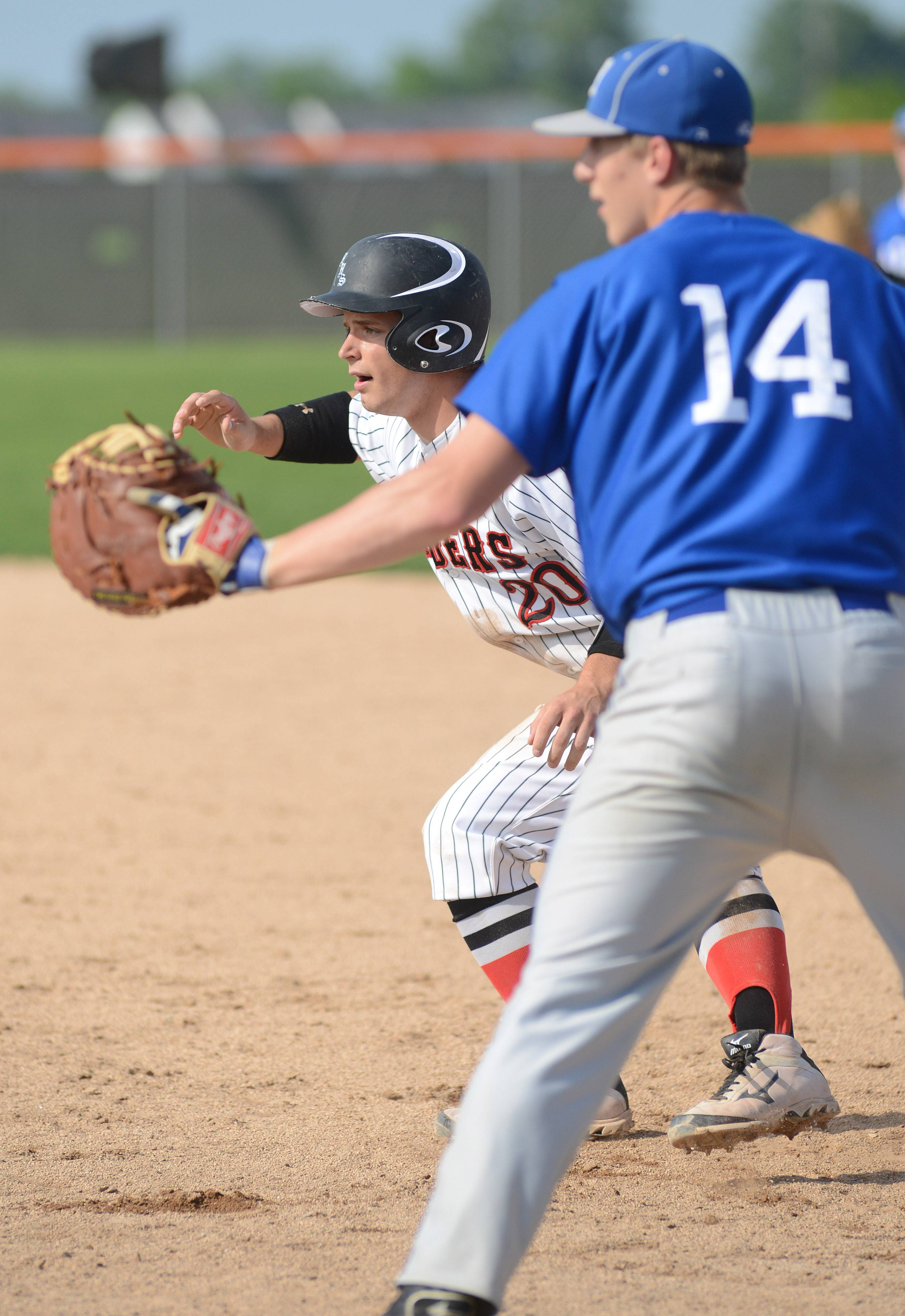 Huntley's Mark Skonieczny leads off first base away from Larkin's Brayden Royse in the fourth inning of the Class 4A regional semifinals at DeKalb High School on Wednesday, May 28.