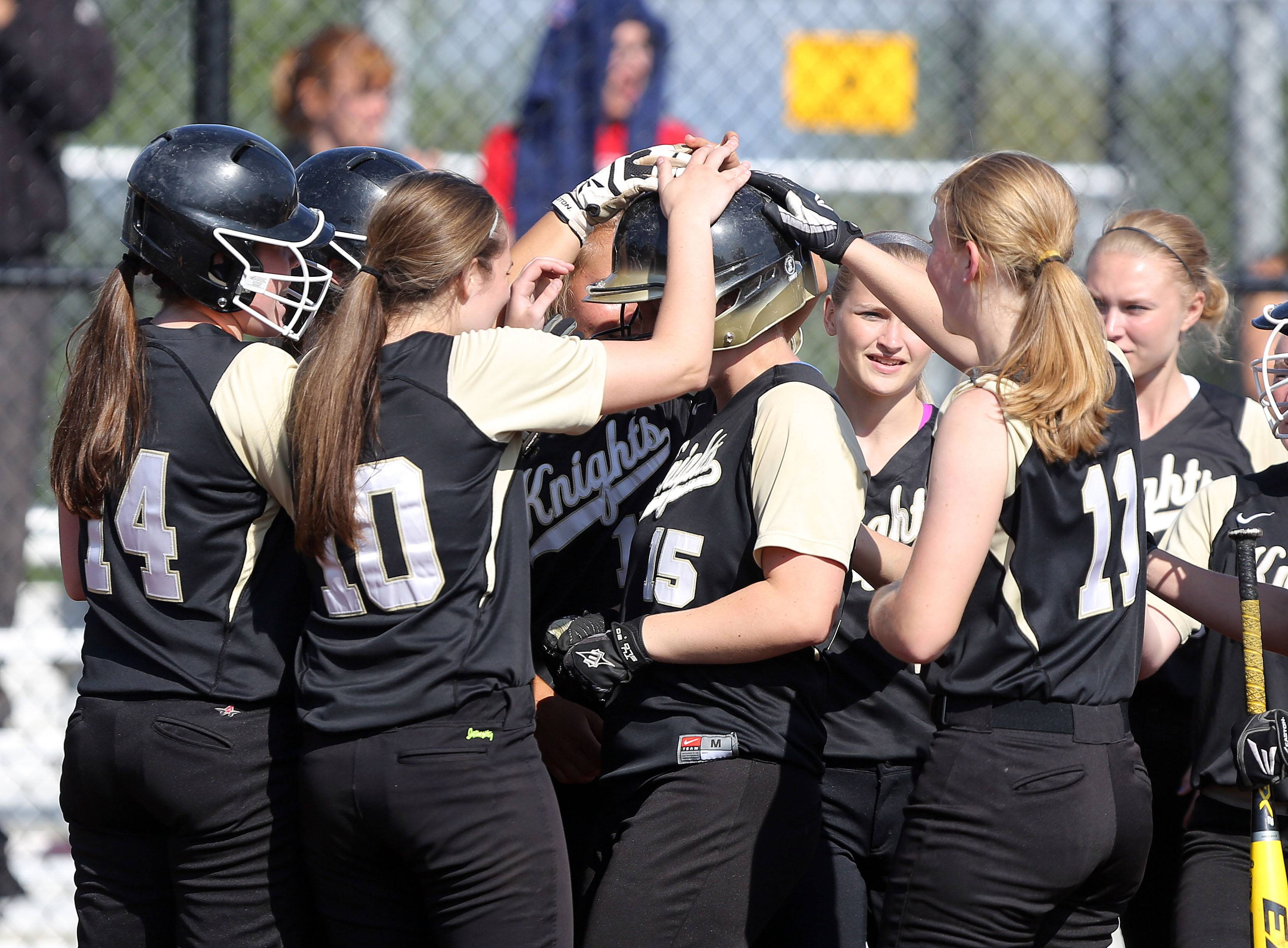 Grayslake North players meet Nikki Livengood at the plate after her home run against Round Lake on Wednesday at Grayslake North.
