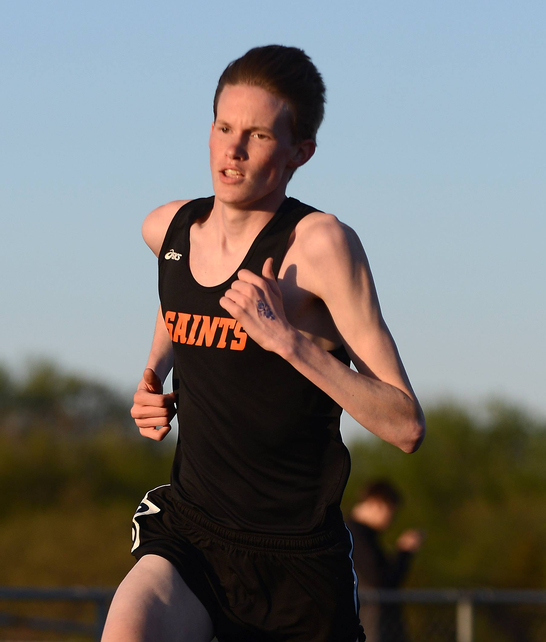 Rick West/rwest@dailyherald.com ¬ St. Charles East's Michael Gerkin won the 3200-meter run at the Kane County boys track meet in Streamwood Friday.