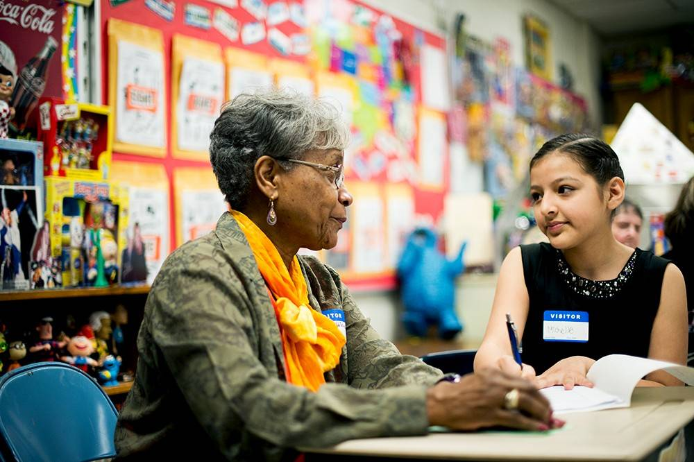 Marva Chubb-Schultz, left, and Michelle Redondo interact at the 11th annual Senior Day at Rupley Elementary school in Elk Grove Village. A full range of events -- including student-conducted interviews, lunch, crafts and games shaped the day.