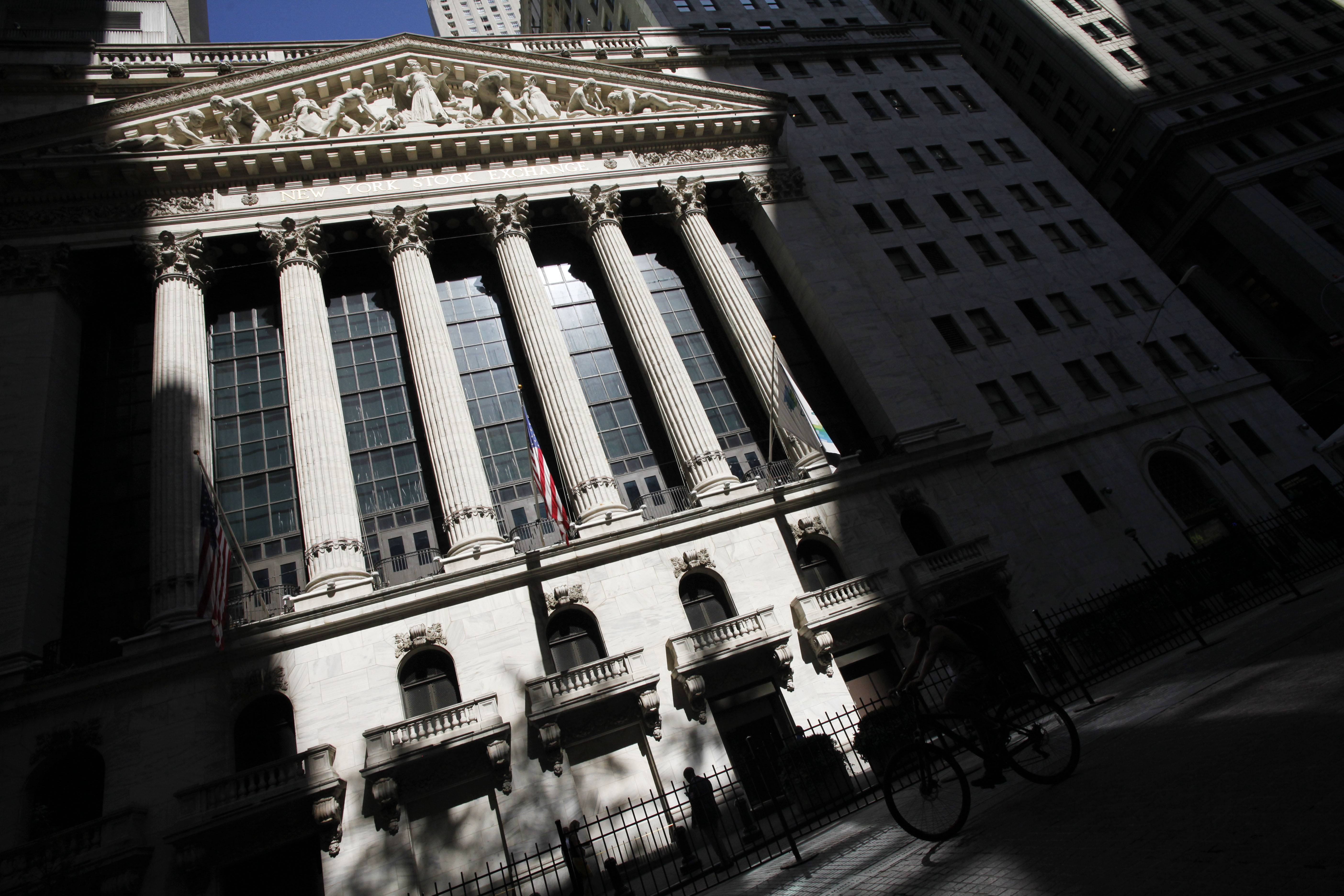 Stocks rose modestly Thursday, sending the Standard & Poor's 500 index to another record high. Investors rallied behind a bidding war in the food industry as well as a somewhat positive report on the U.S. labor market.