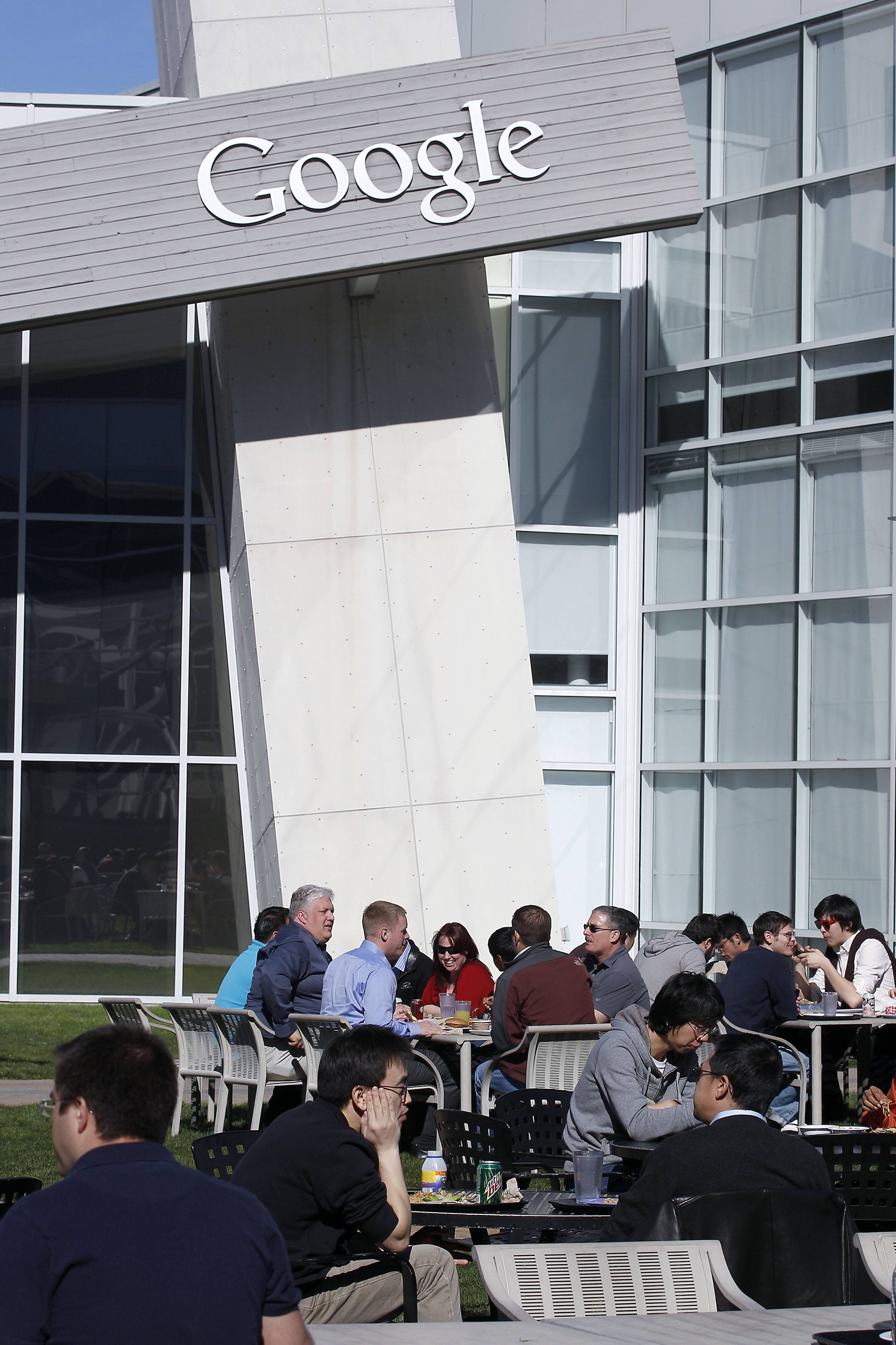 Google Inc. employees sit outside during lunch time at company's headquarters in Mountain View, California. In a groundbreaking disclosure, Google revealed Wednesday how very white and male its workforce is — just 2 percent of its 50,000 Googlers are black, 3 percent are Hispanic, and 30 percent are women.