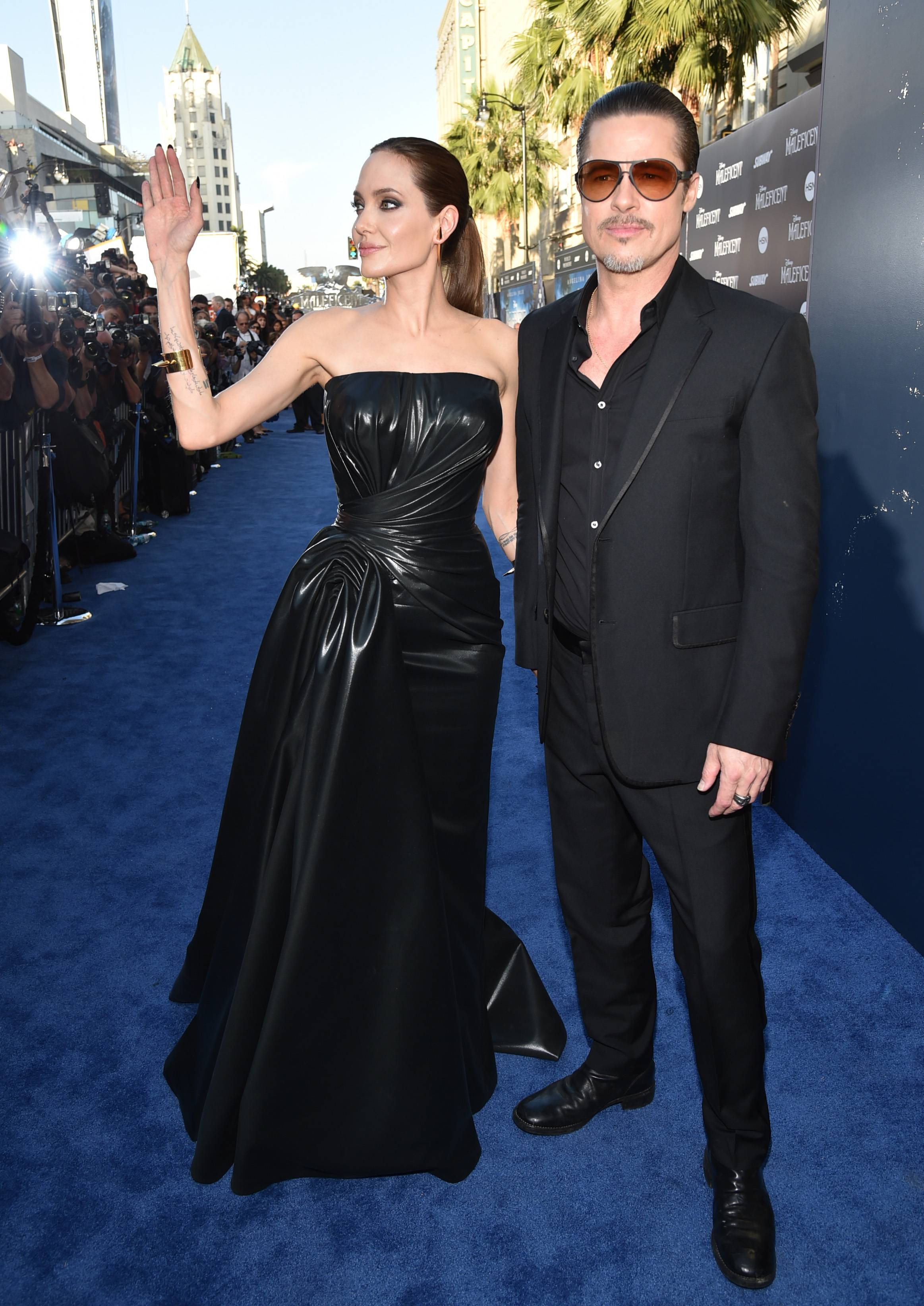 "Angelina Jolie and Brad Pitt arrive at the world premiere of ""Maleficent"" at the El Capitan Theatre on Wednesday in Los Angeles."