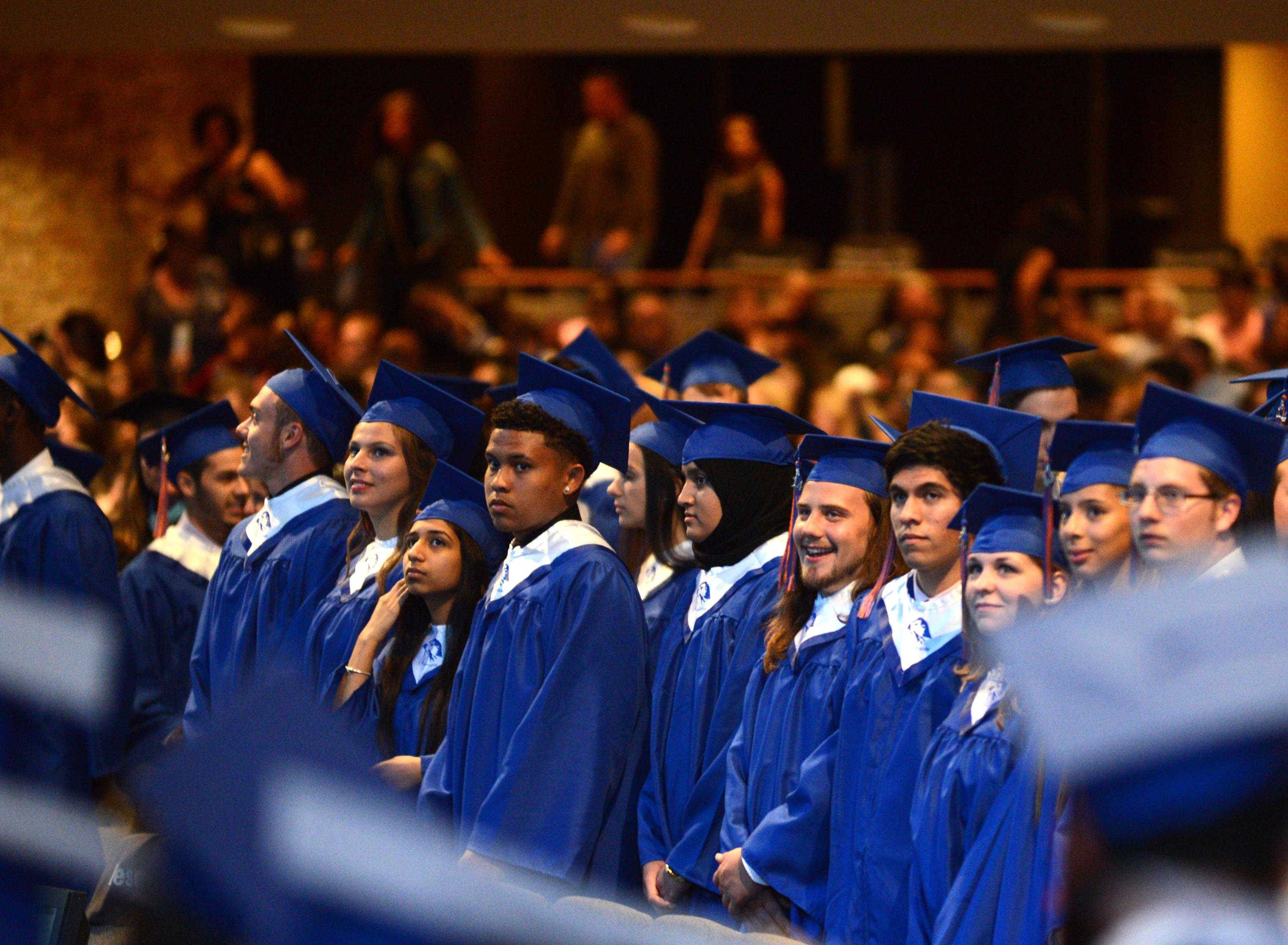 Members of the Class of 2014 file into the auditorium at Willow Creek Church in South Barrington on Thursday night for the Hoffman Estates High School graduation.