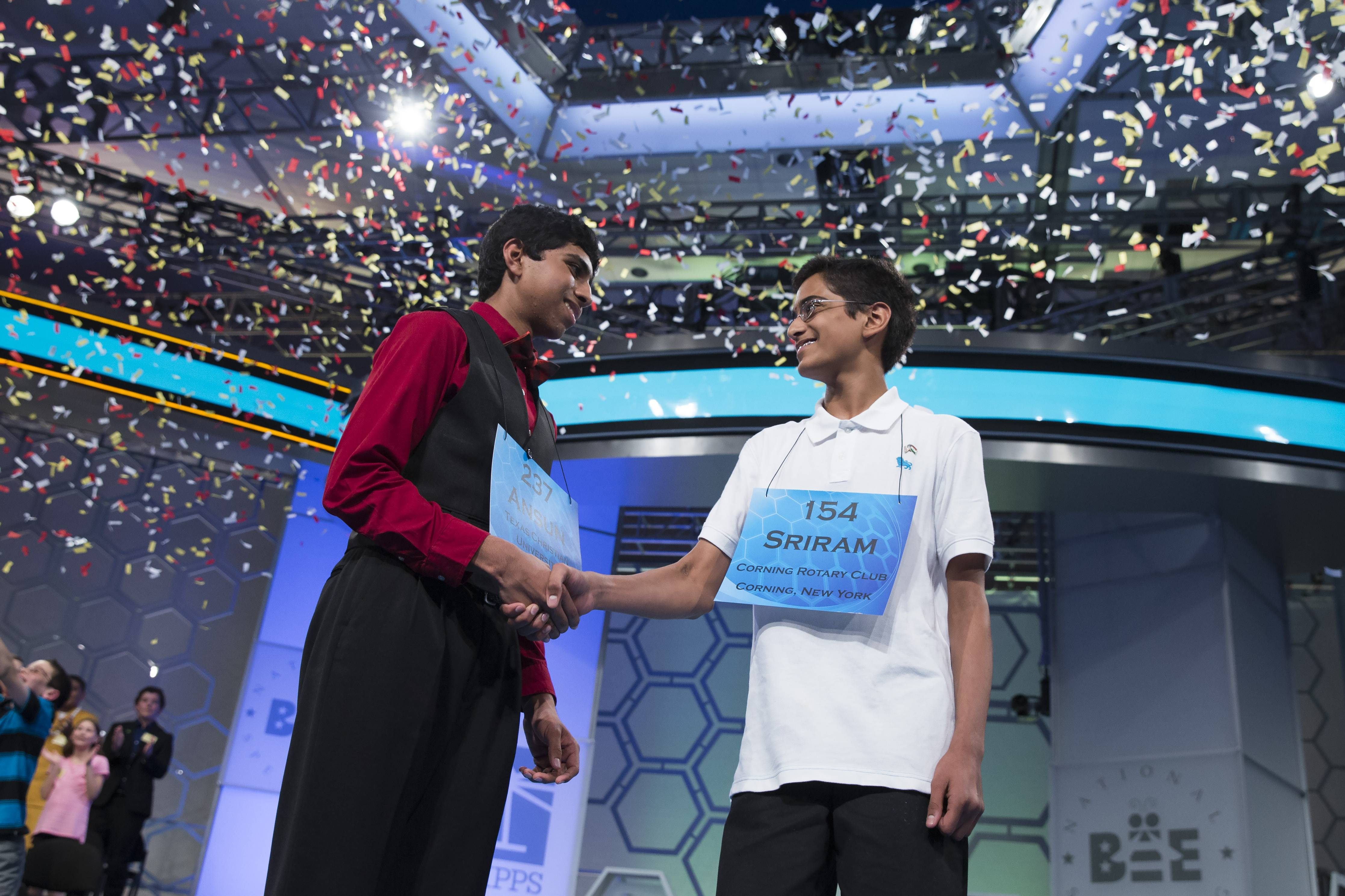 Ansun Sujoe, 13, of Fort Worth, Texas, left, and Sriram Hathwar, 14, of Painted Post, N.Y., shake hands after being named co-champions of the National Spelling Bee on Thursday.