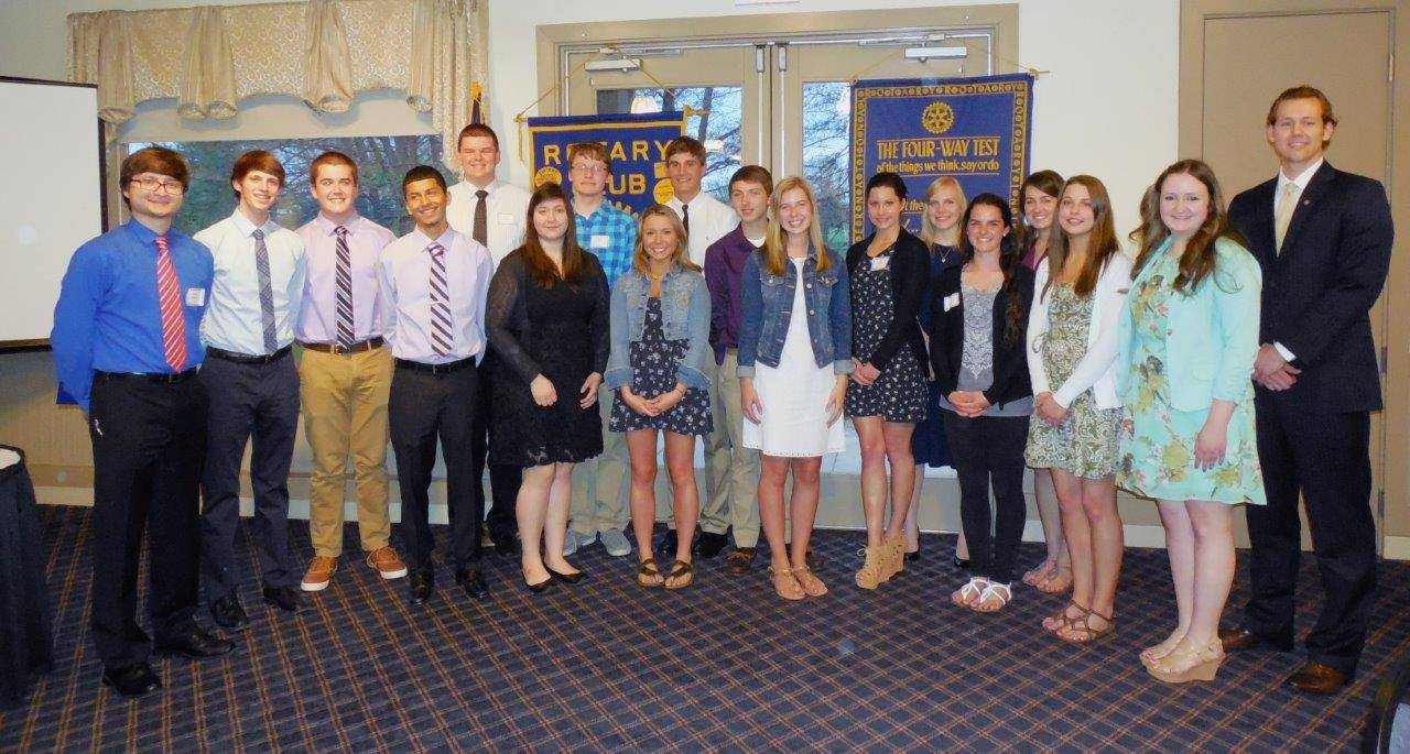 The Dundee Township Rotary Club, with club president Erik Gullickson, right, recently awarded $28,500 in scholarships to 19 students. From left, Samuel Baker, Colin Stiefer, Thomas Rice, Francisco Nava, Trent Hanselmann, Jasmin Trujillo, Eric Faler, Carly Stallings, Nick Munson, Andrew Cassiere, Katelyn Aschacher, Erin Jameson, Samantha Hoyt, Kelly Grady, Libby Atchison, Megan Jameson, and Katherine Conomikes. Not pictured: Allison Nason and Vanessa Martinez.