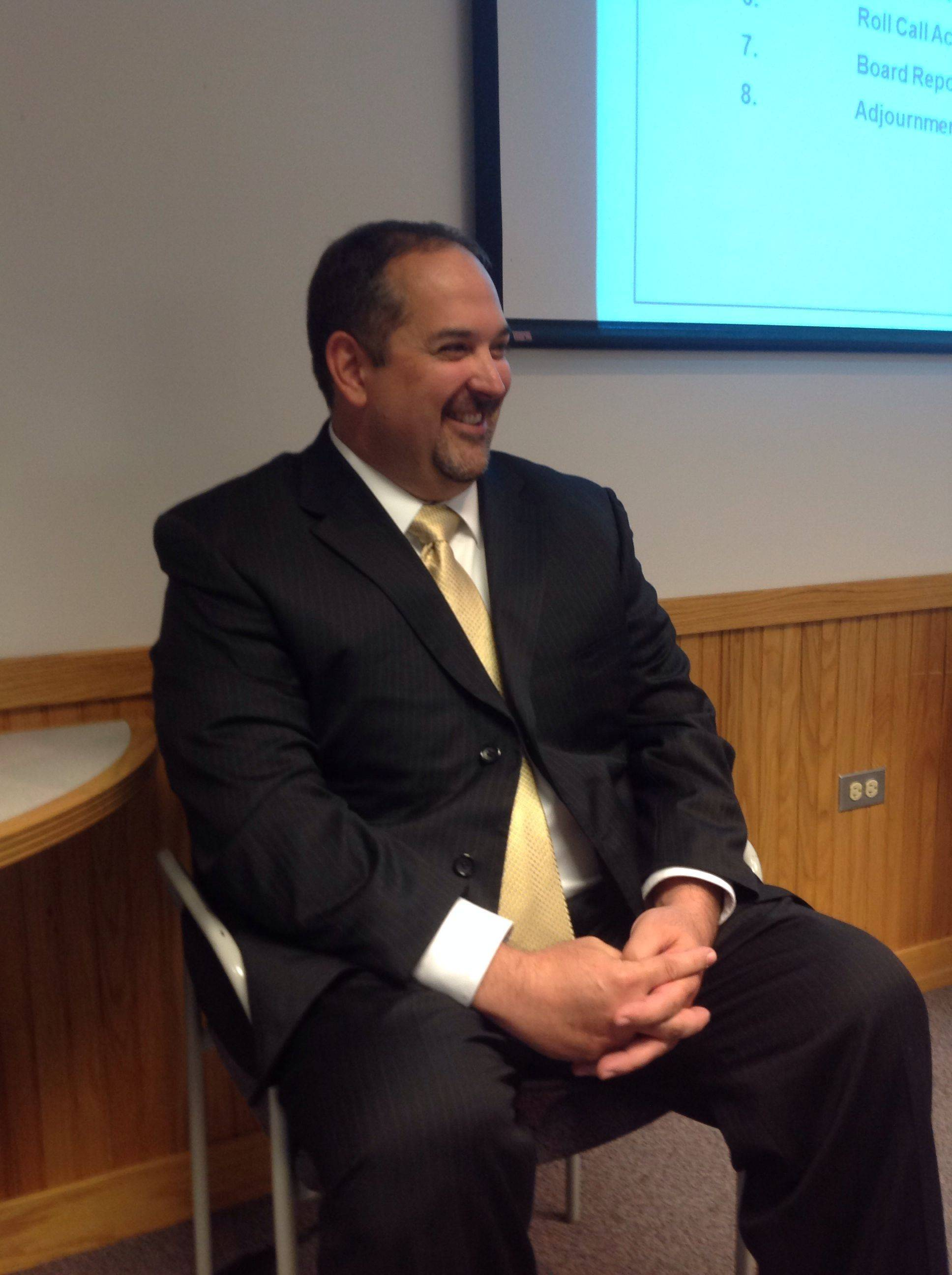 Fred Heid, the next superintendent of Community Unit District 300, smiles Wednesday after the school board approves his employment contract. Heid, 43, can't take over as superintendent until the state verifies his credentials. He will work as chief executive officer while the district's former superintendent, Ken Arndt, serves as interim superintendent.