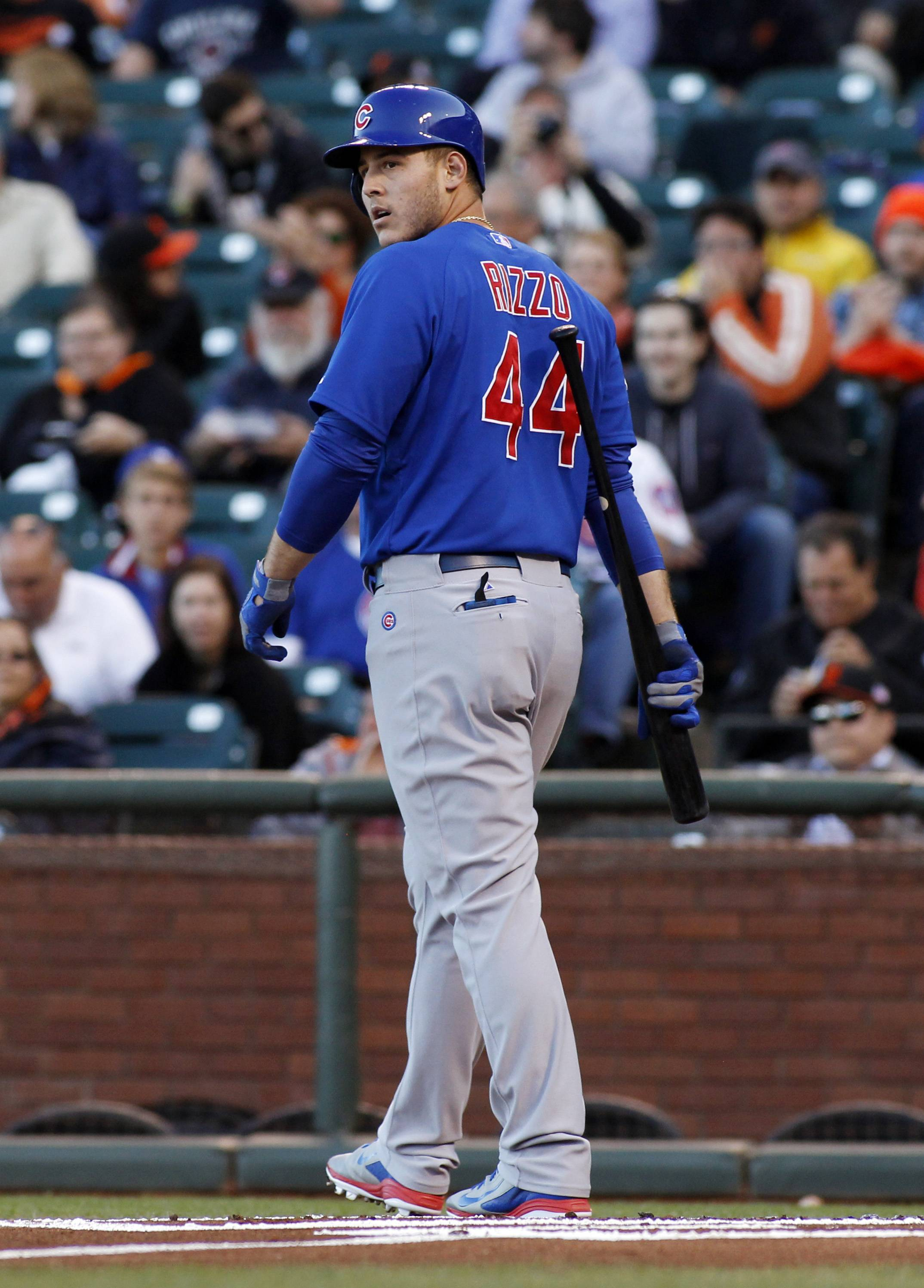 Chicago Cubs' Anthony Rizzo looks back after striking out against the San Francisco Giants during the first inning of a baseball game, Tuesday, May 27, 2014, in San Francisco. (AP Photo/George Nikitin)