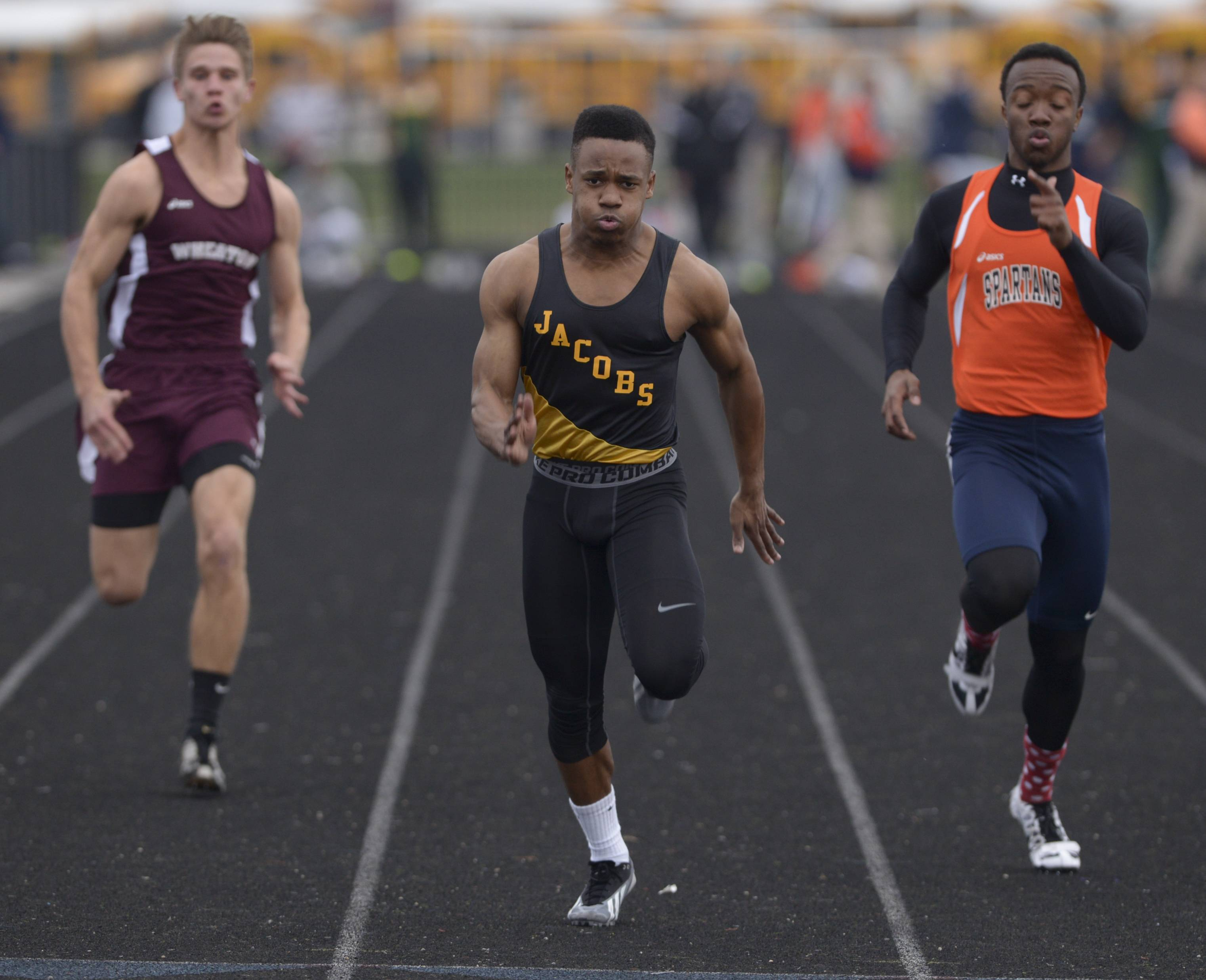 Jacobs' Josh Walker, center, competes in the 100-meter dash during the Gus Scott Track and Field Invitational at Naperville North earlier this season. Walker will compete in the event at the Class 3A state meet in Charleston this weekend.