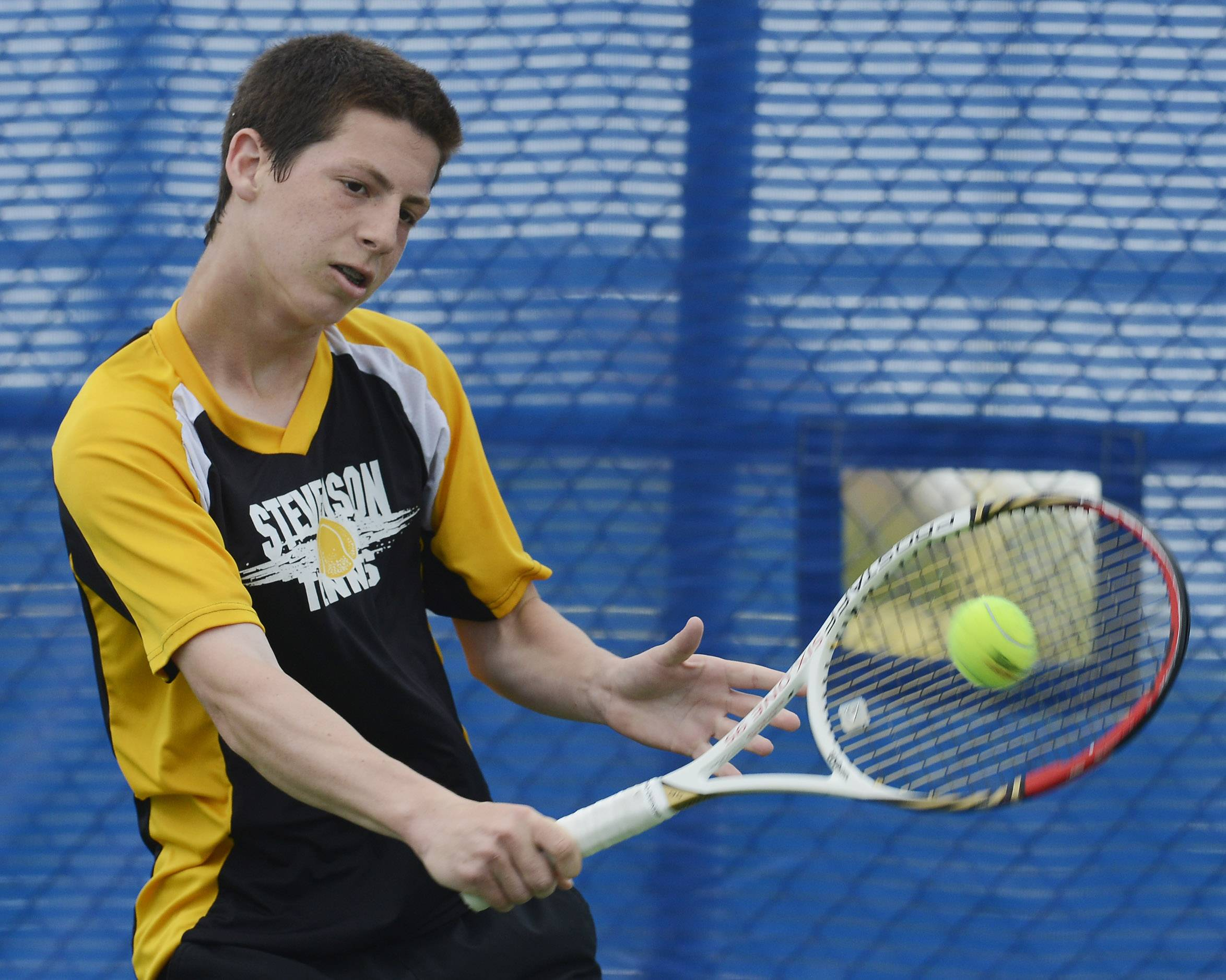 Stevenson's Benjamin Bush returns a shot during the boys tennis state tournament at Hoffman Estates High School on Thursday.