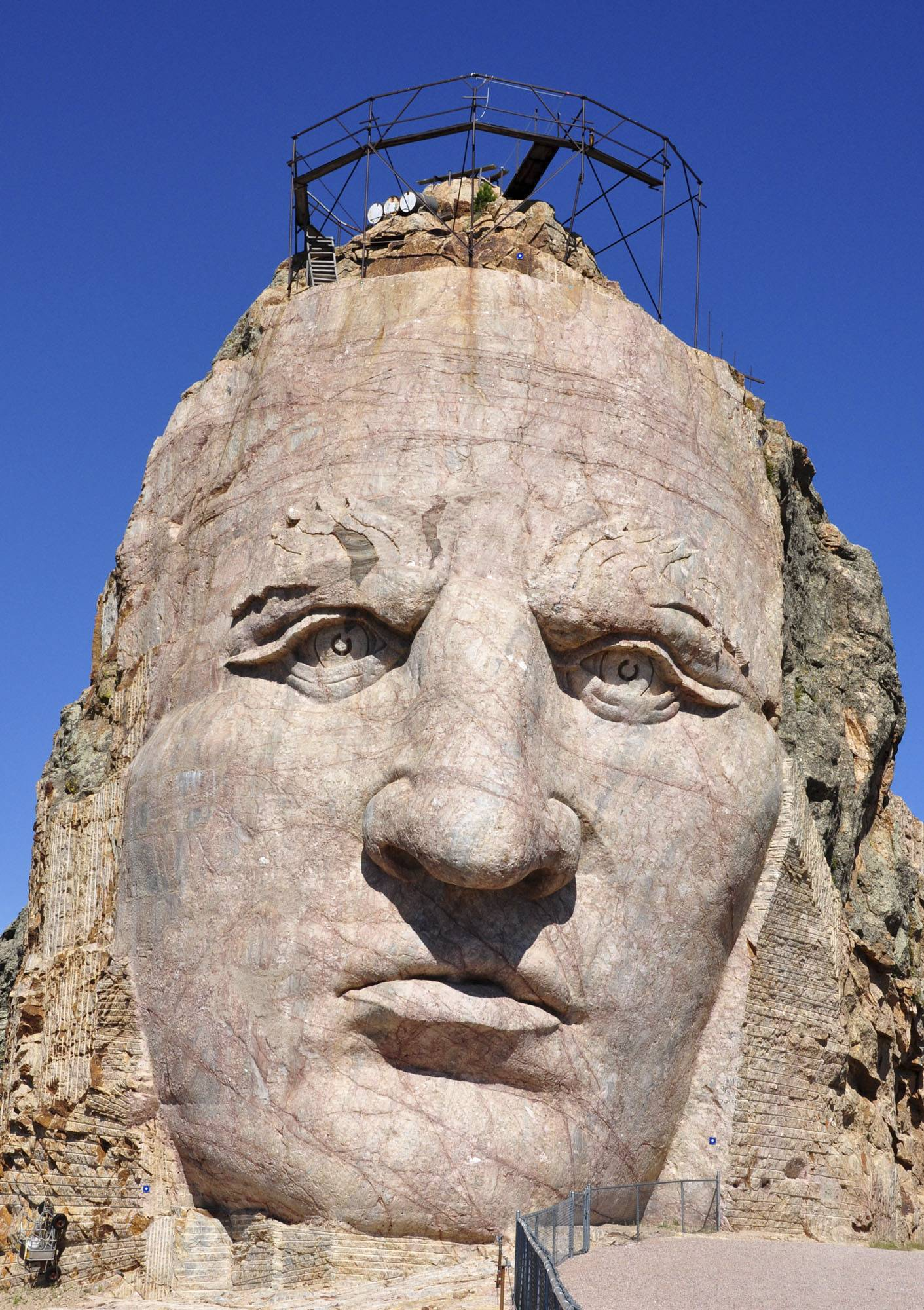 The 87-foot-6-inch tall face of the Crazy Horse mountain carving near Custer, S.D., remains slow going. But it will continue, even after the death of Ruth Ziolkowski, the widow of sculptor Korczak Ziolkowski and president and chief executive of the memorial.