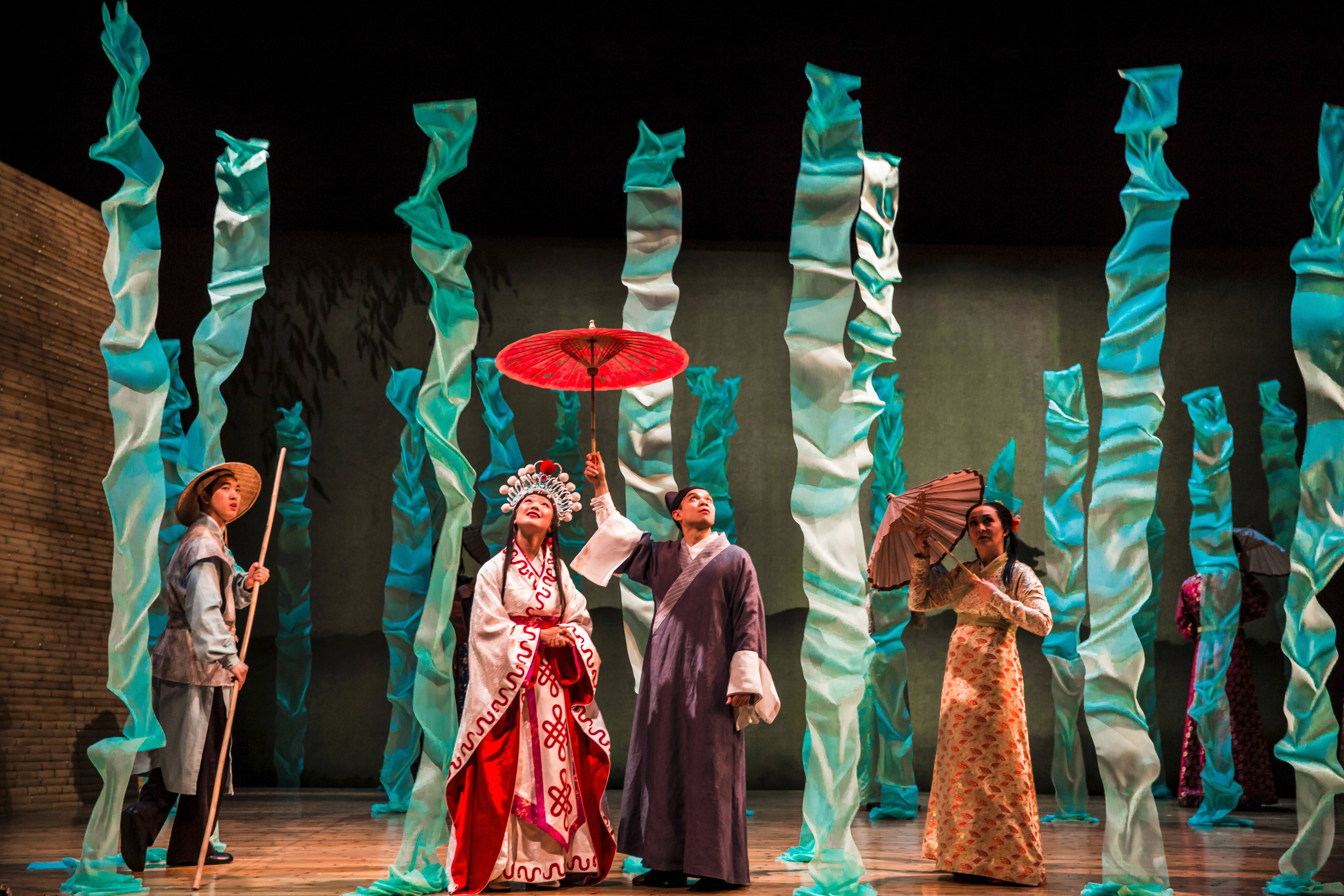 "Vin Kridakorn, left, stars with Amy Kim Waschke, Jon Norman Schneider and Lisa Tejero in director Mary Zimmerman's production of the ancient Chinese tale of ""The White Snake"" at Goodman Theatre in Chicago."