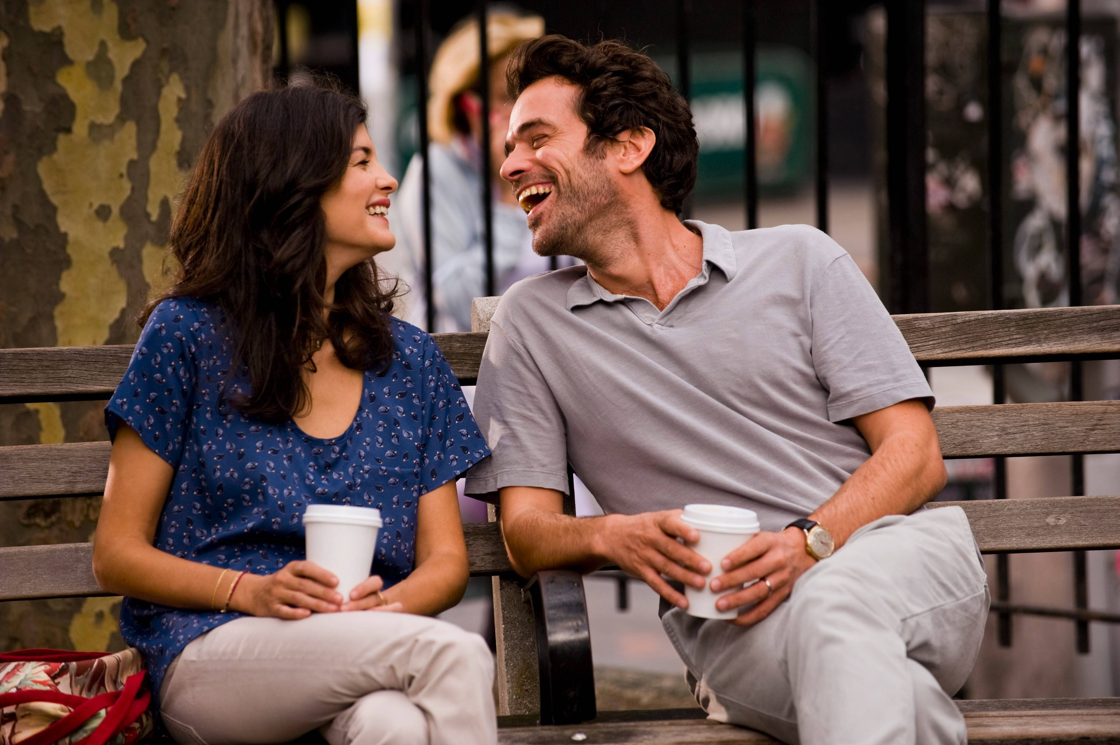 "Xavier (Romaine Duris) shares a laugh with an old French flame (Audrey Tautou) in the domestic romance ""Chinese Puzzle."""