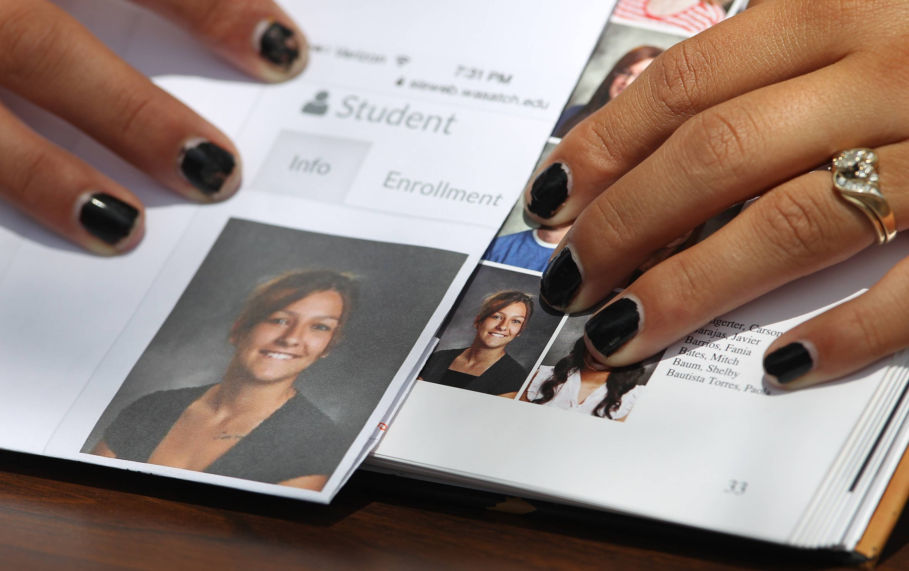 Wasatch High School sophomore Shelby Baum, 16, points to yearbook proof, left, and her altered school yearbook photo, right.