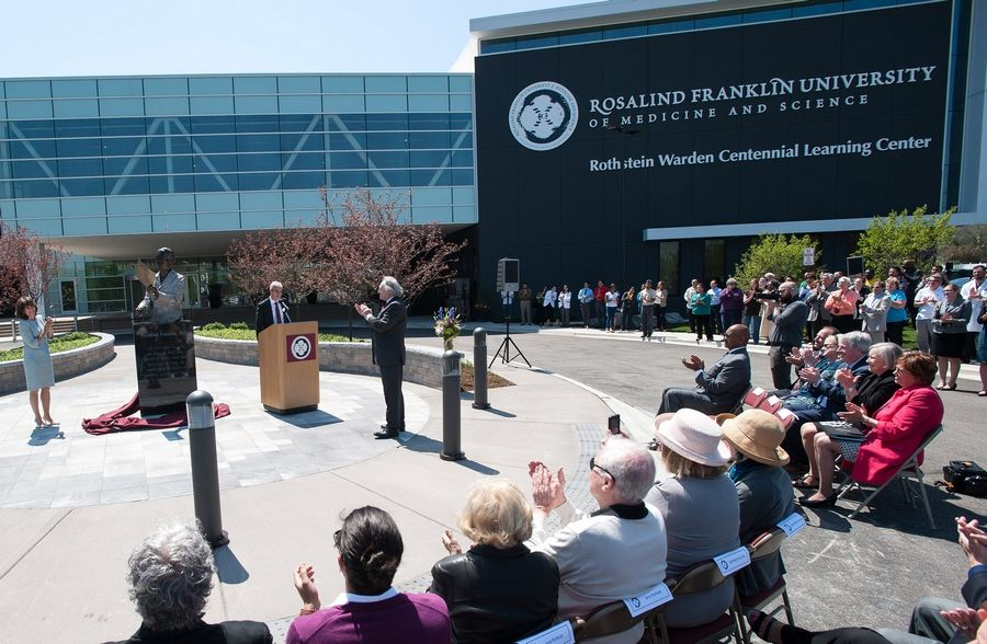 Rosalind Franklin University of Medicine and Science unveils a bronze statue of its namesake Thursday in North Chicago. The late-British scientist's Photo 51 was crucial to the 1953 discovery of the structure of DNA.