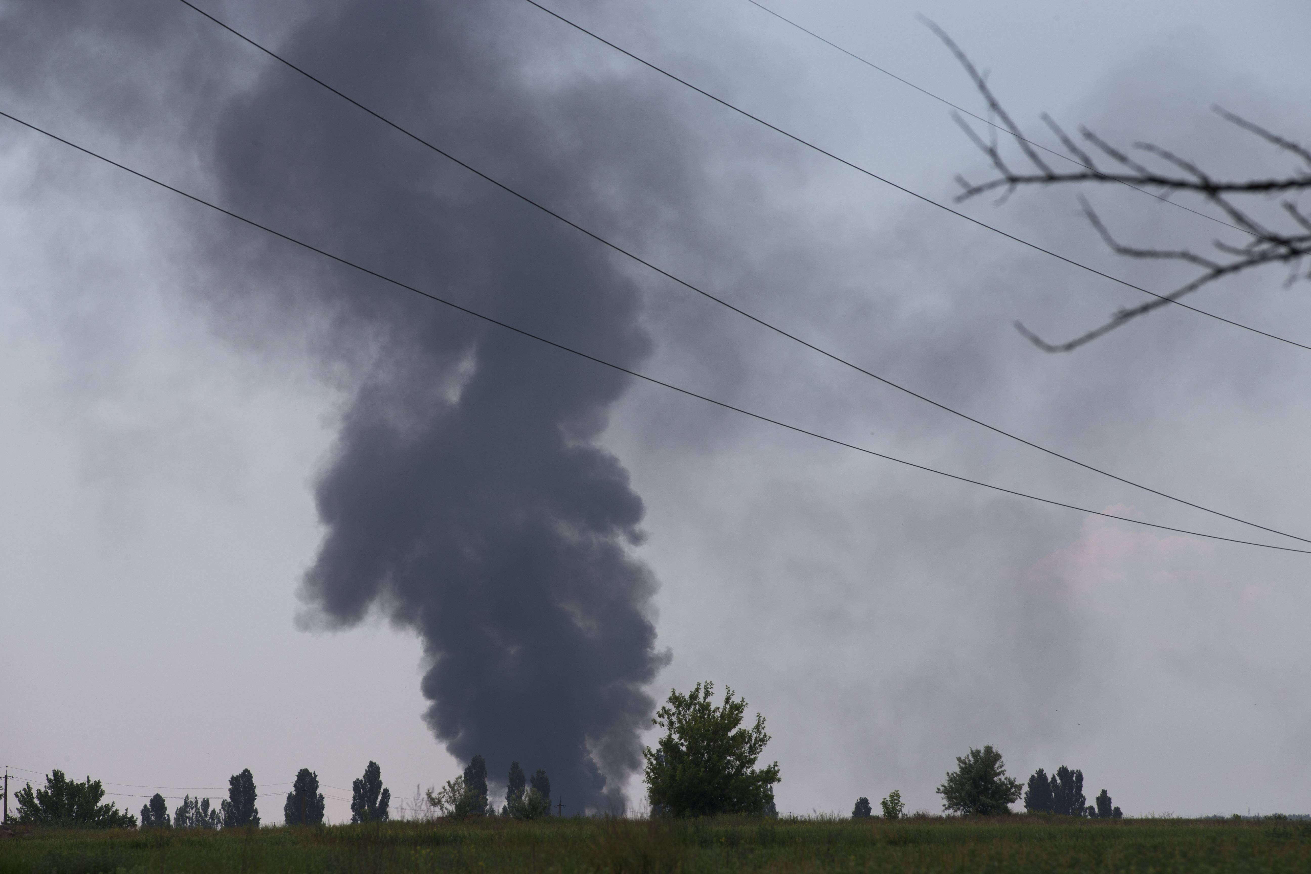 Rebels in eastern Ukraine shot down a government military helicopter Thursday amid heavy fighting around the eastern city of Slovyansk, killing 12 soldiers including a general, Ukraine's leader said.